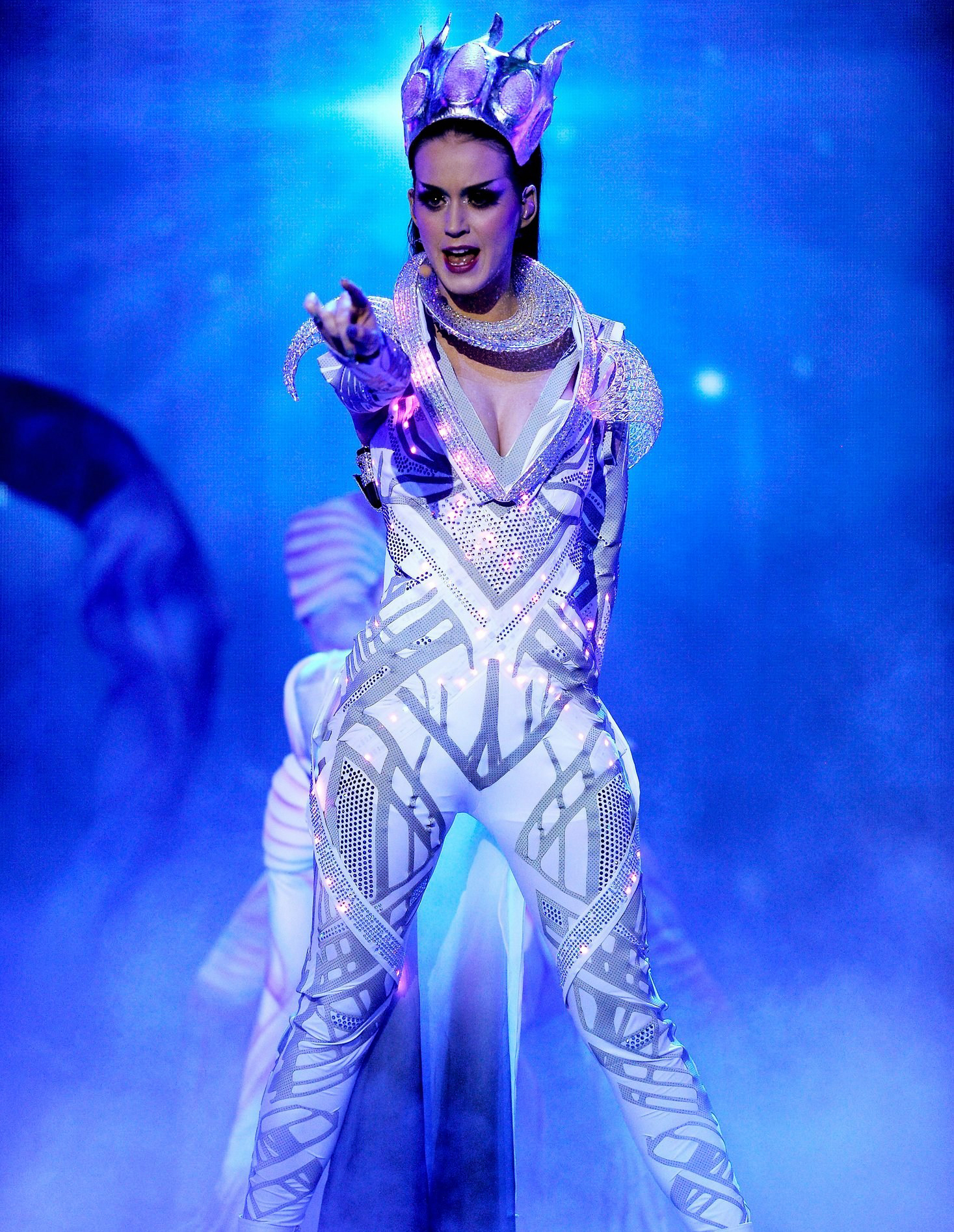 American singer Katy Perry performs E.T. on April 21, 2011, on the stage of American Idol show. She wears a catsuit from english brand CuteCircuit, whose interactive LEDs chatter on Swarovski crystals.