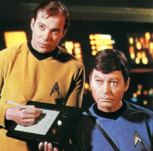 Dr. McCoy (DeForest Kelley) and Kirk already know the the tablet computer ancestor. Subsequently, in other derived series, the PADD (Personal Access Display Device) will delight not only Starfleet members but also other alien civilizations.