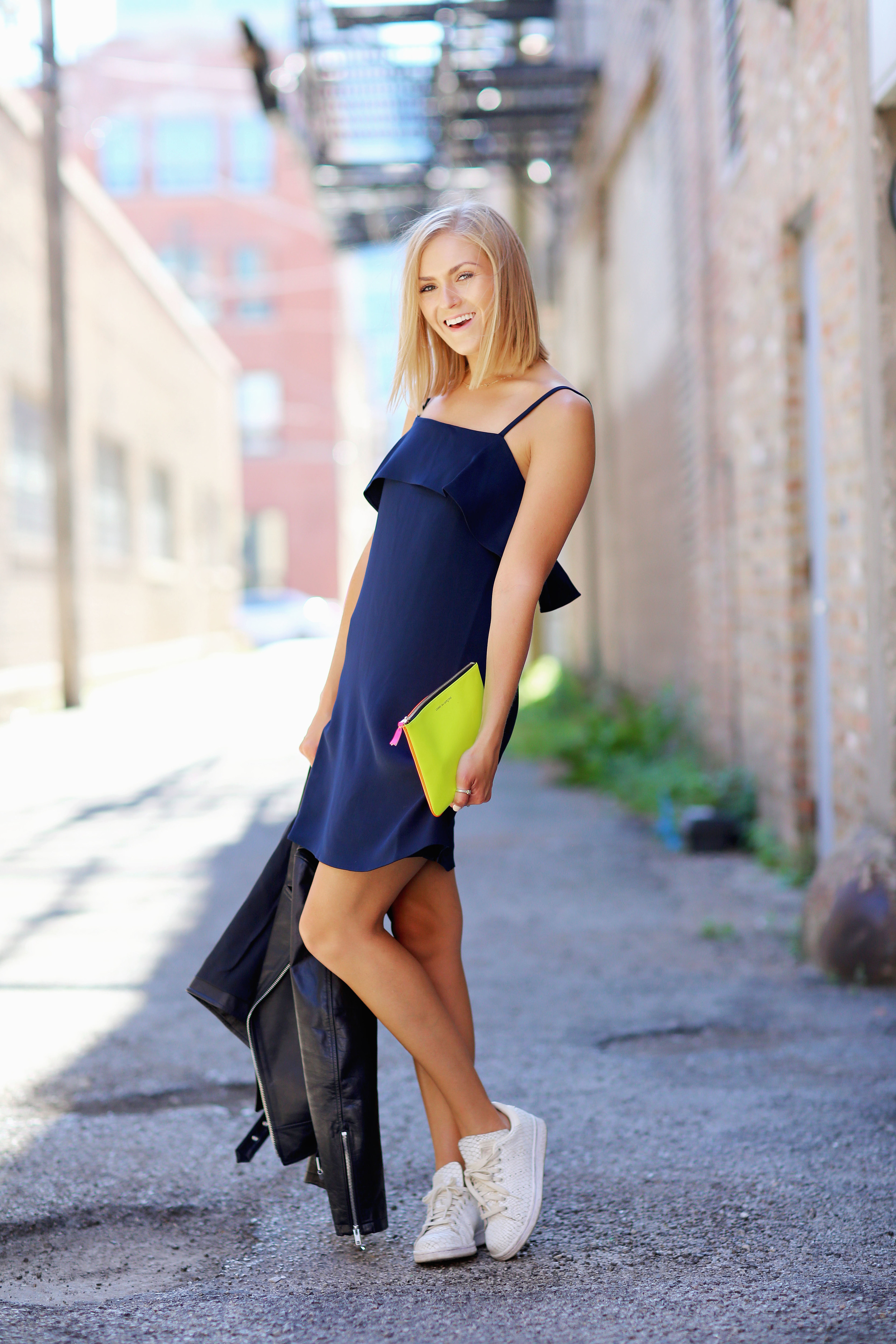 slip dress with sneakers and clutch.jpg