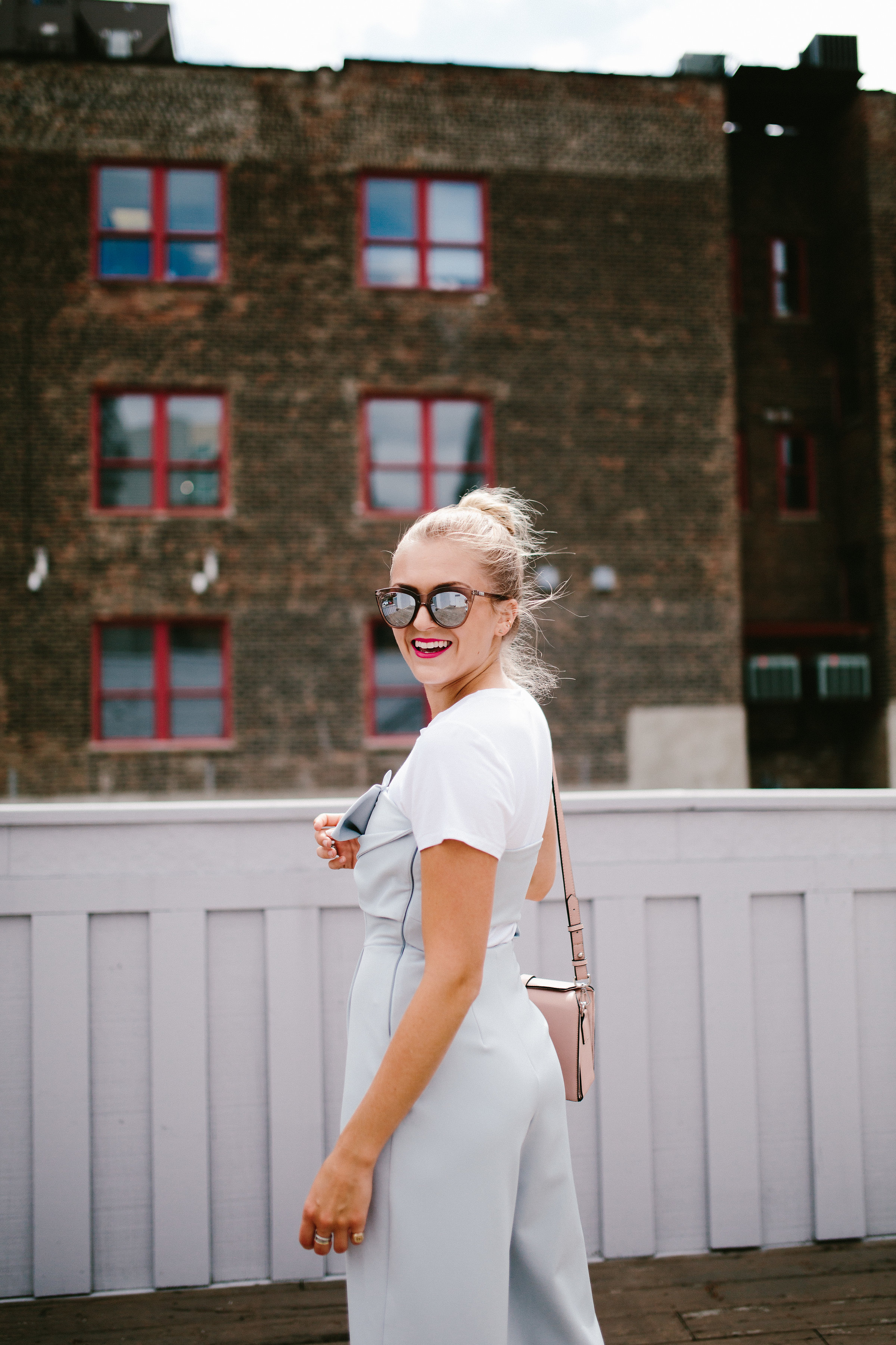 girl smile city view mirrored sunglasses