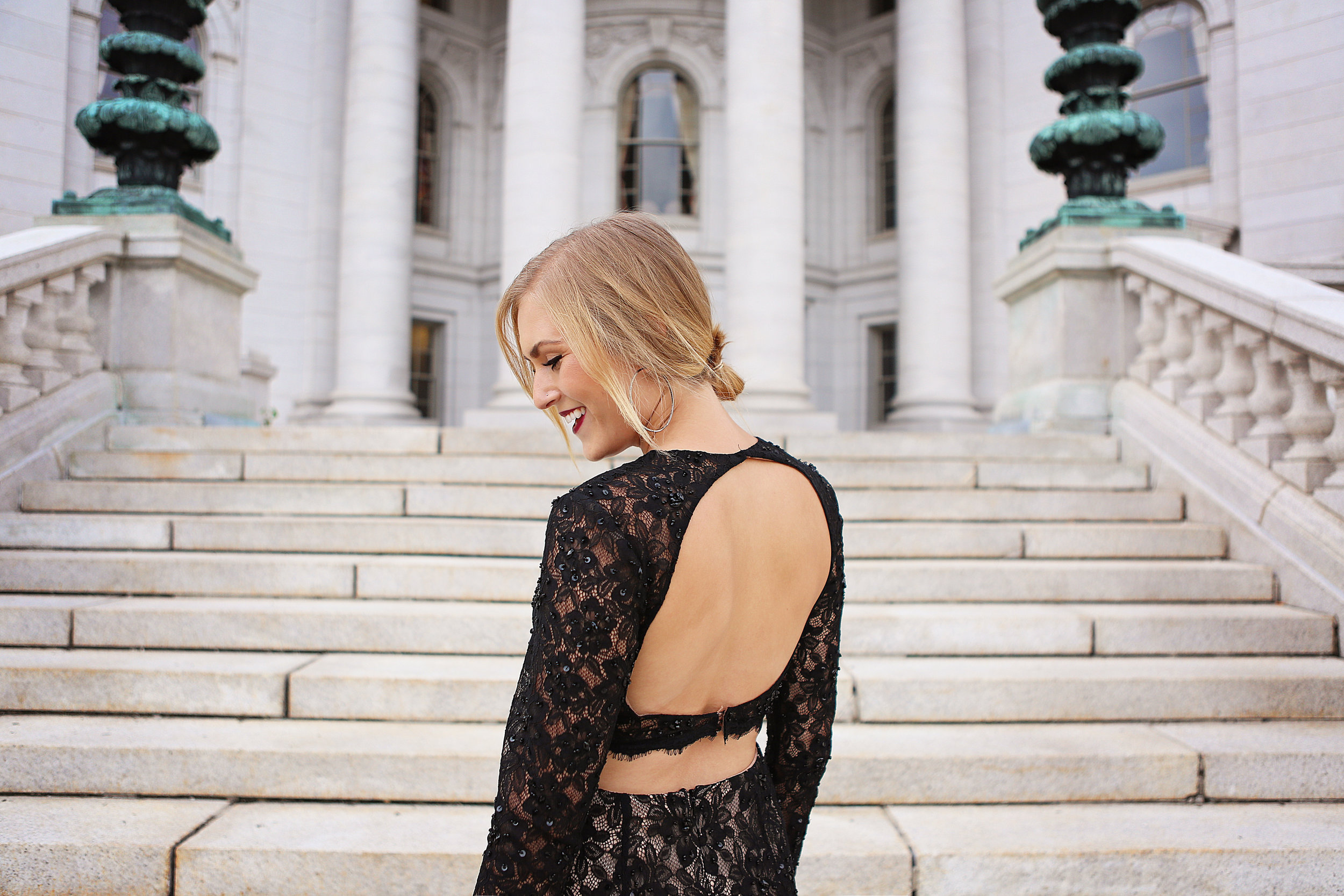 blonde girl open back gown