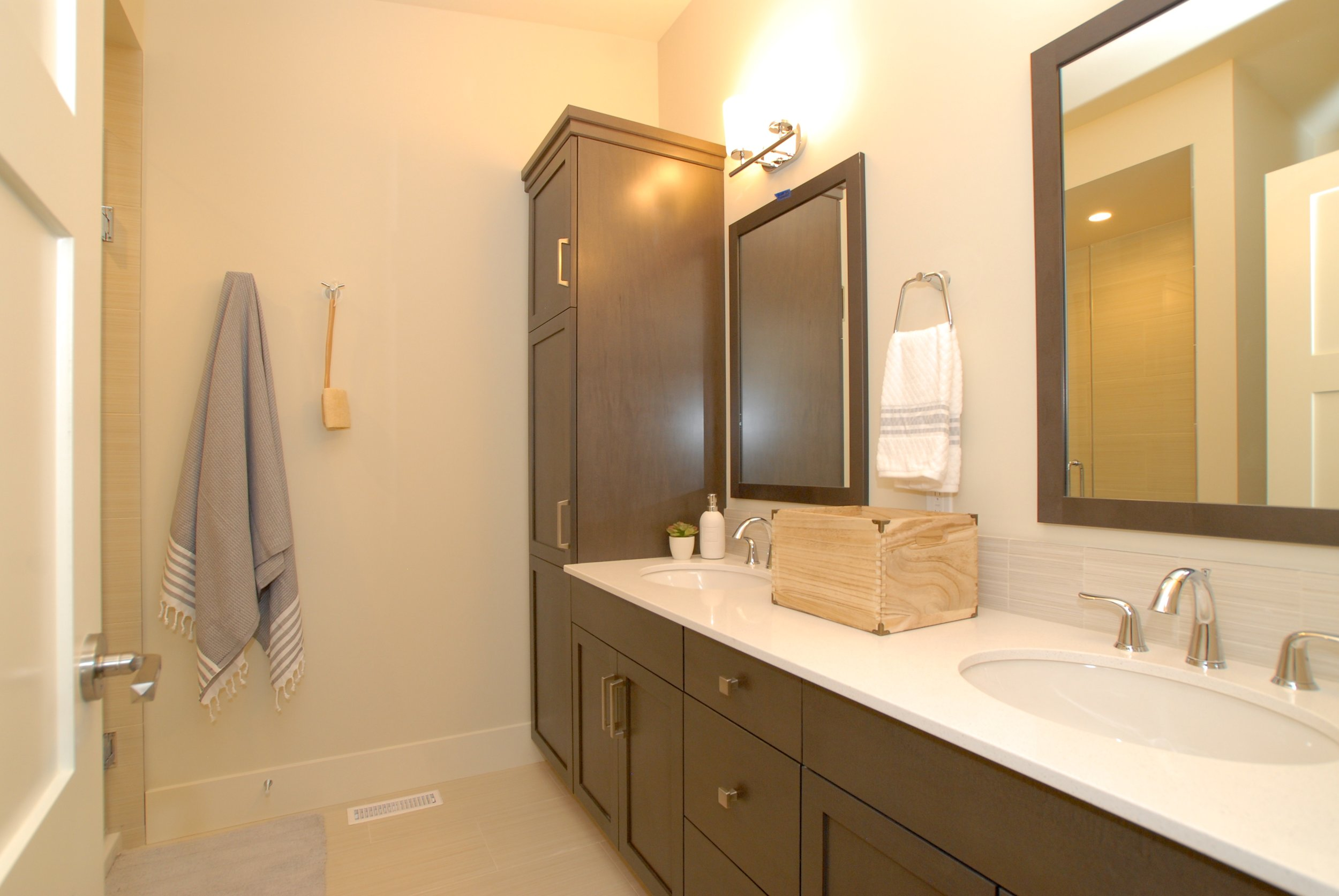 Double vanity with built-in linen tower