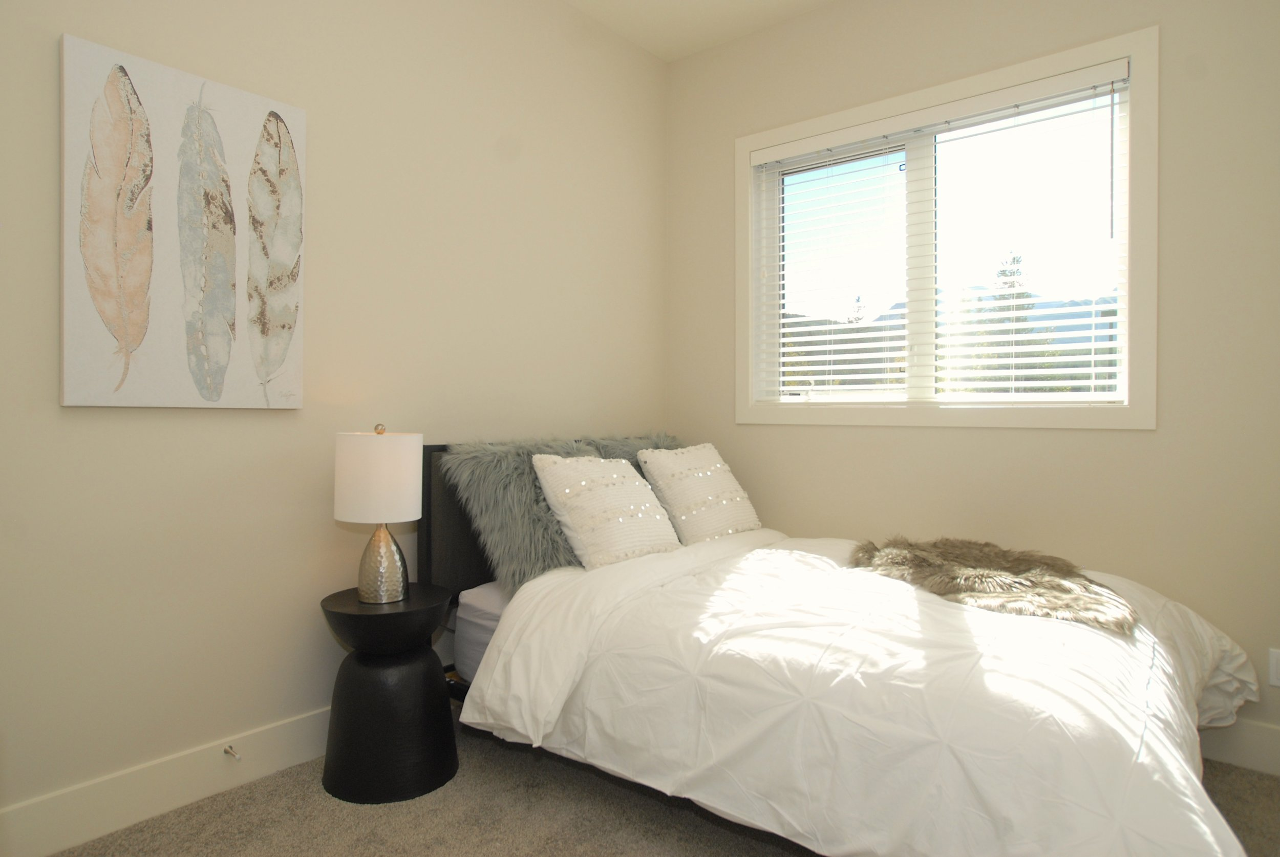 2nd bedroom filled with natural light
