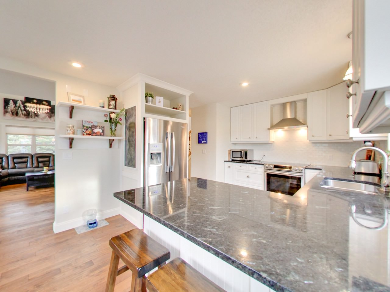 Timeless kitchen remodel featuring granite counters.