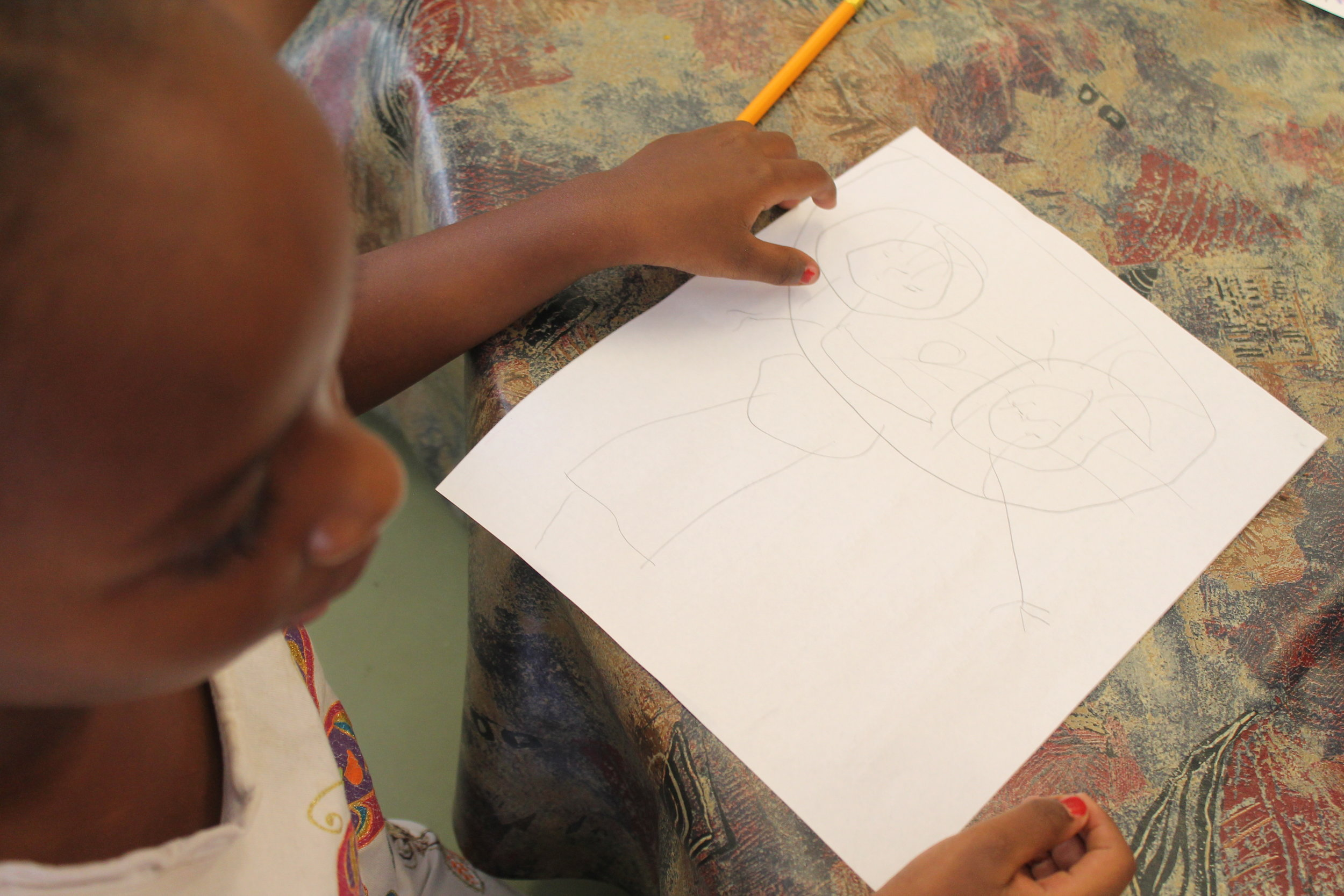 """This child drew her work of art entitled """"This is my mother"""""""