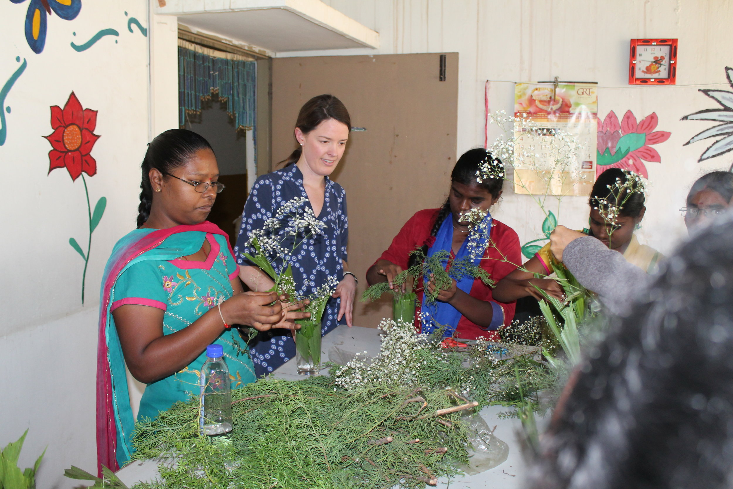 """At a flower design session with women in sewing job-training program, Esther shared of God's love for them, more than the """"lilies of the valley and the flowers of the field"""". Given these womens' parents refusal to allow them education, tis message especially resonated with them."""