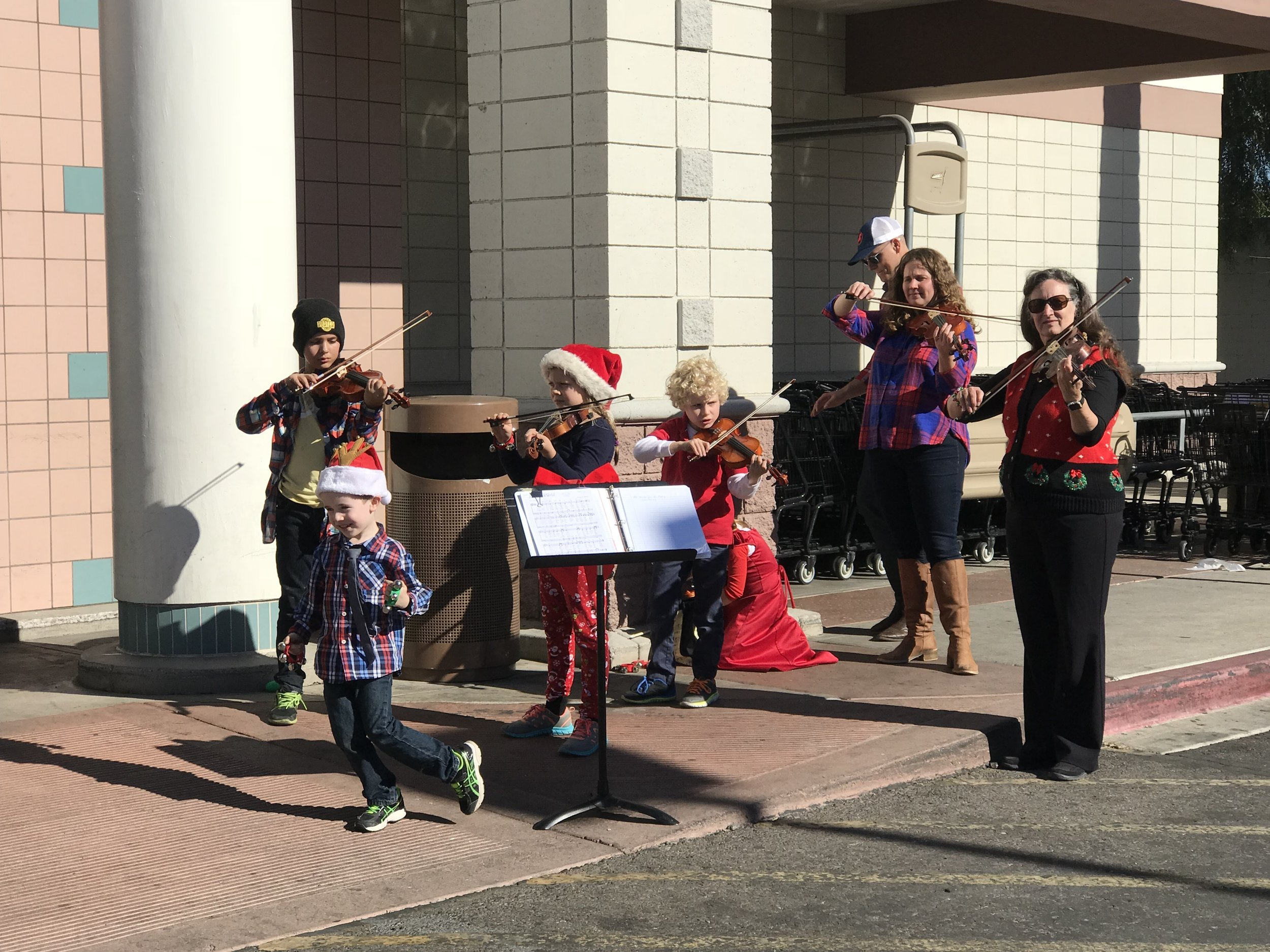 Carol and Brad Routh orchestrated their grandchildren to play Christmas carols encouraging the busy shoppers to stop, listen and donate to the Salvation Army Red Kettle.