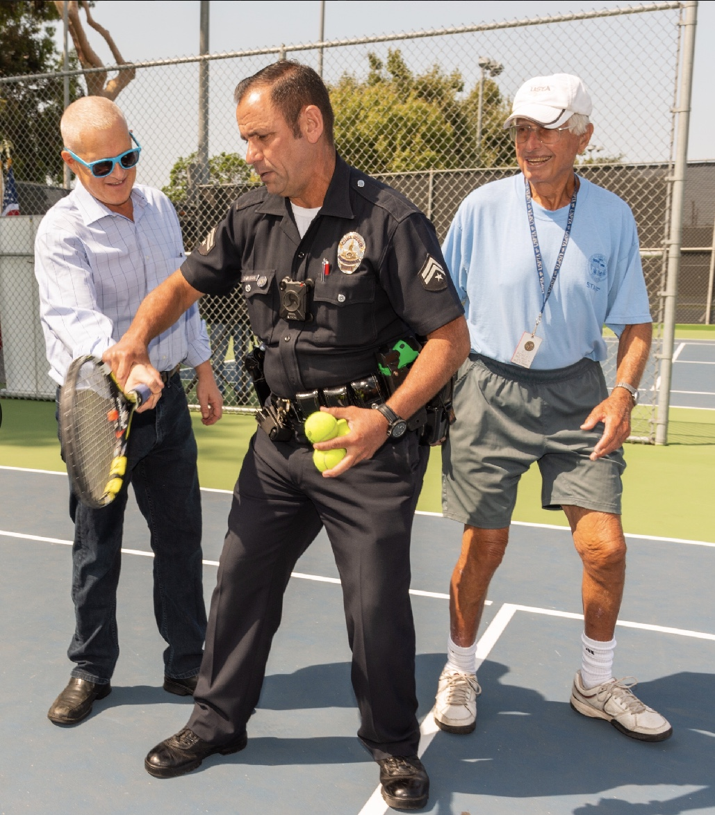 SLO James Lavenson demonstrates proper forehand technique to Councilmember Mike Bonin. Hitting the ball in front of you appears to be the lesson.