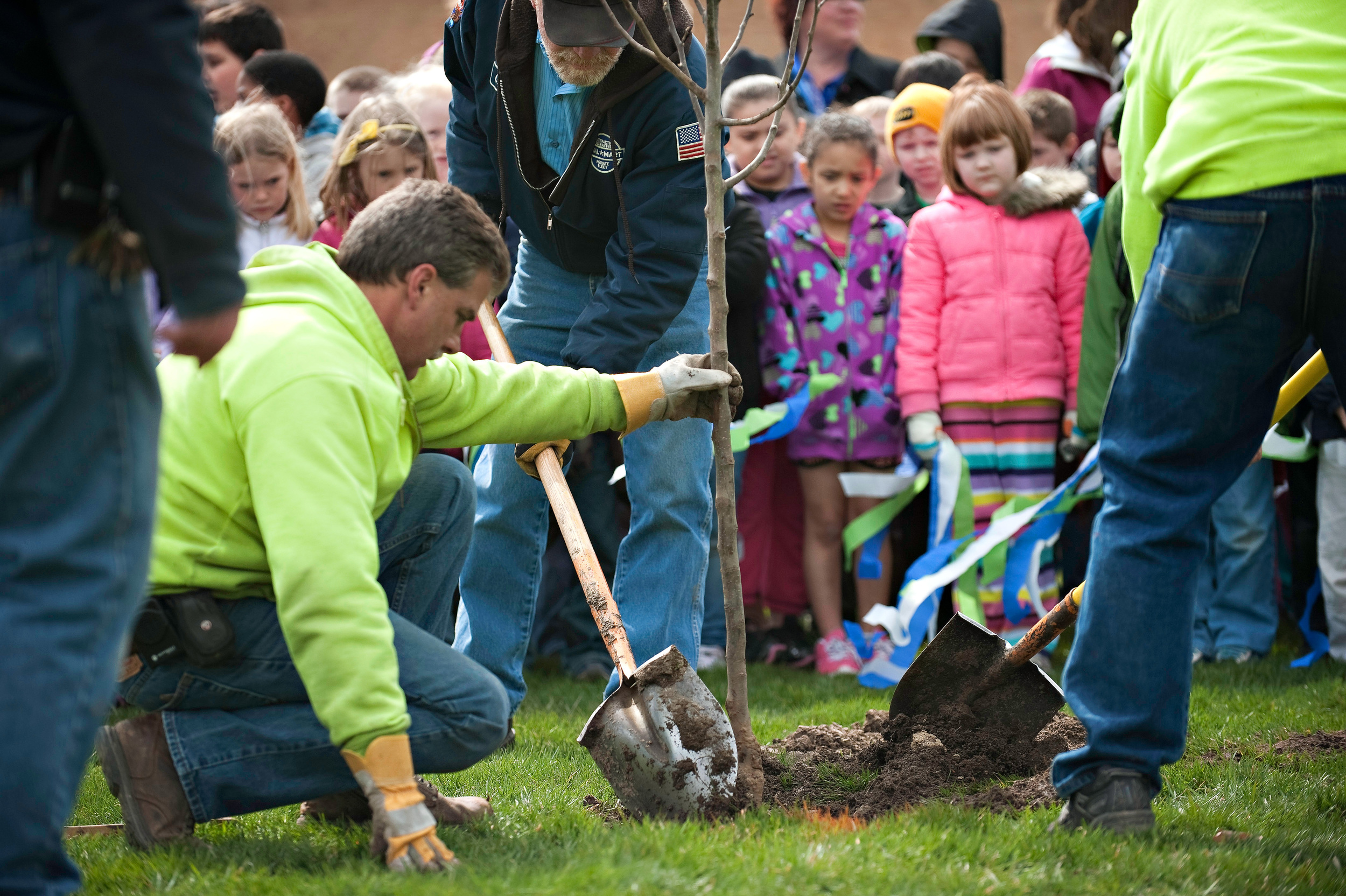 City of Beaver Dam parks & forestry team teaching children the importance of planting trees.