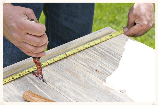 Use a putty knife to gap the tongue and groove boards evenly to set the overall with for each panel.