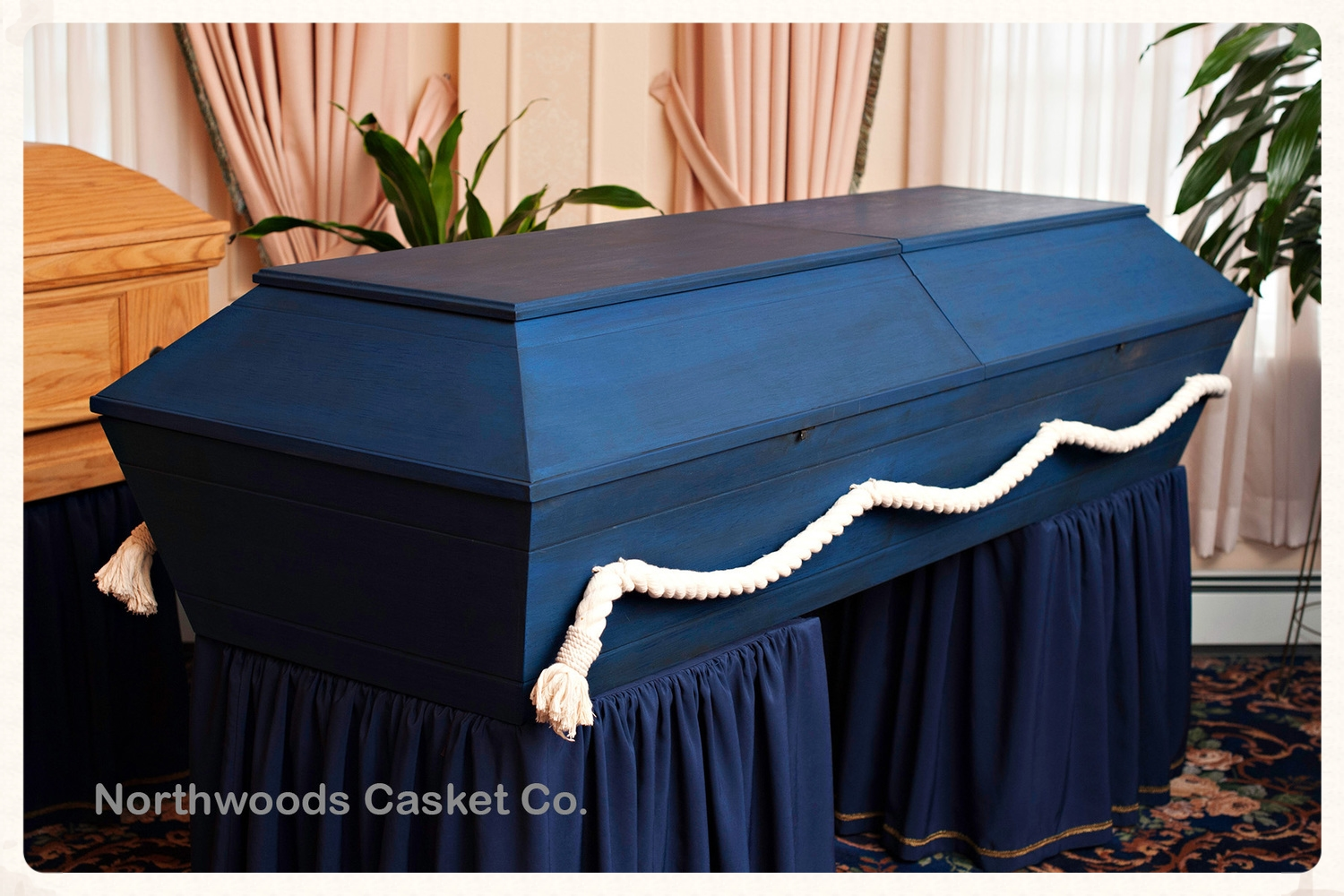 This casket was painted with two coats of blue milk paint followed by two coats of dark raw tung oil for a rich ocean water affect.