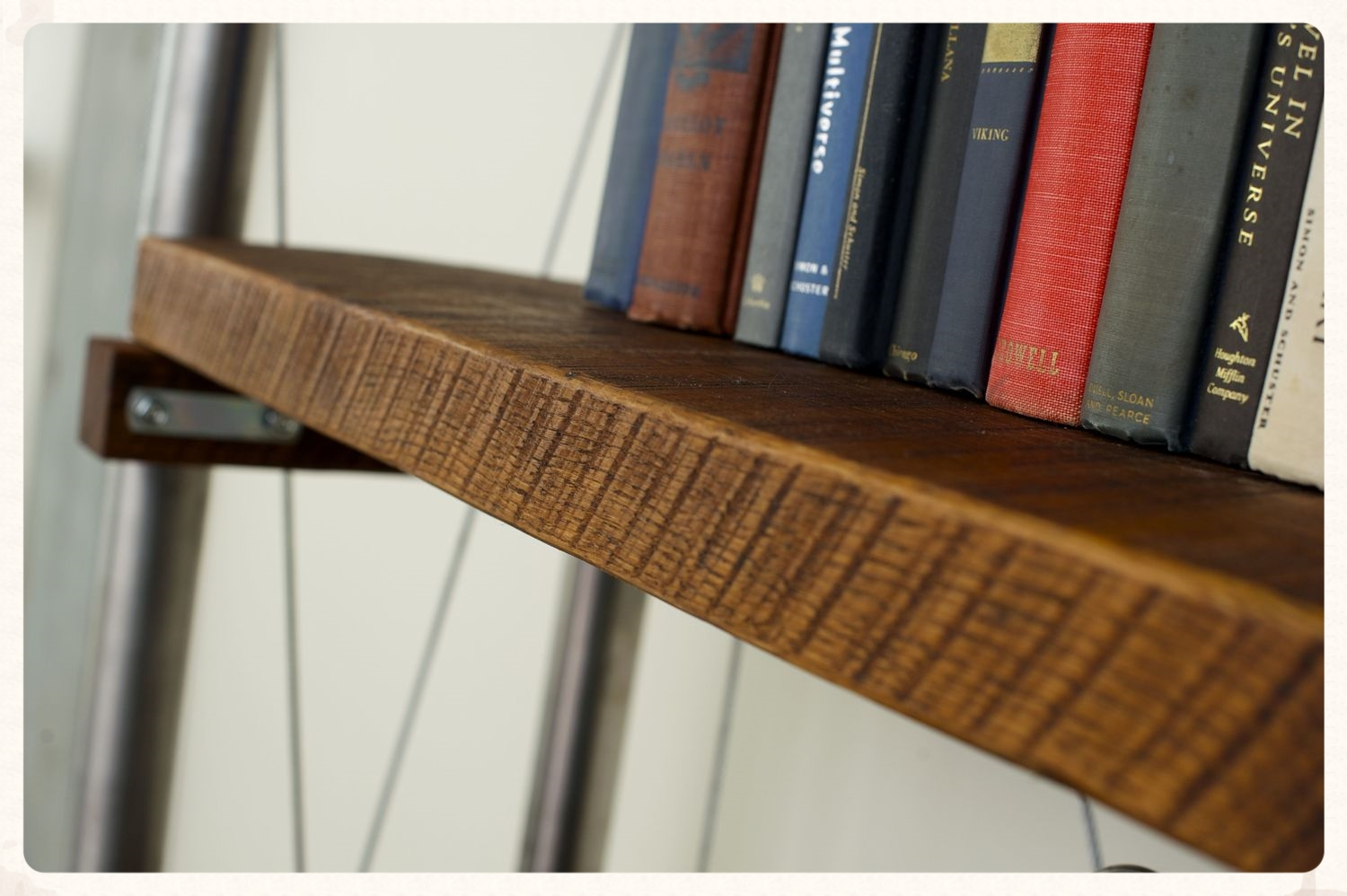 Dark raw tung oil fills in the detail enhancing the saw marks on rough sawn oak plank shelving.