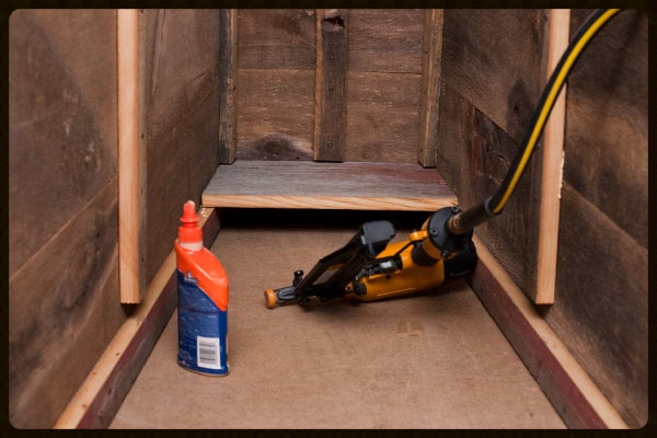 Figure 5 - First floorboard installed a the toe end of the coffin.