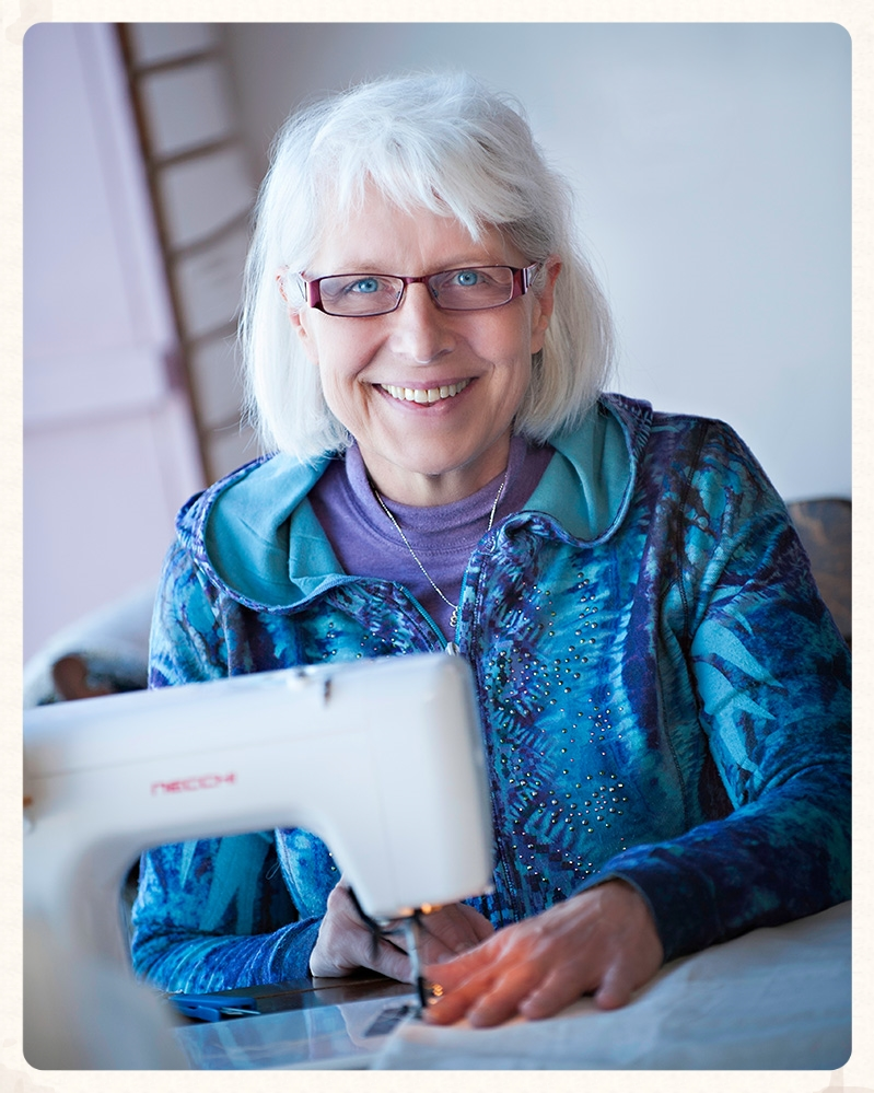 Our seamstress, Sally, always smiling.