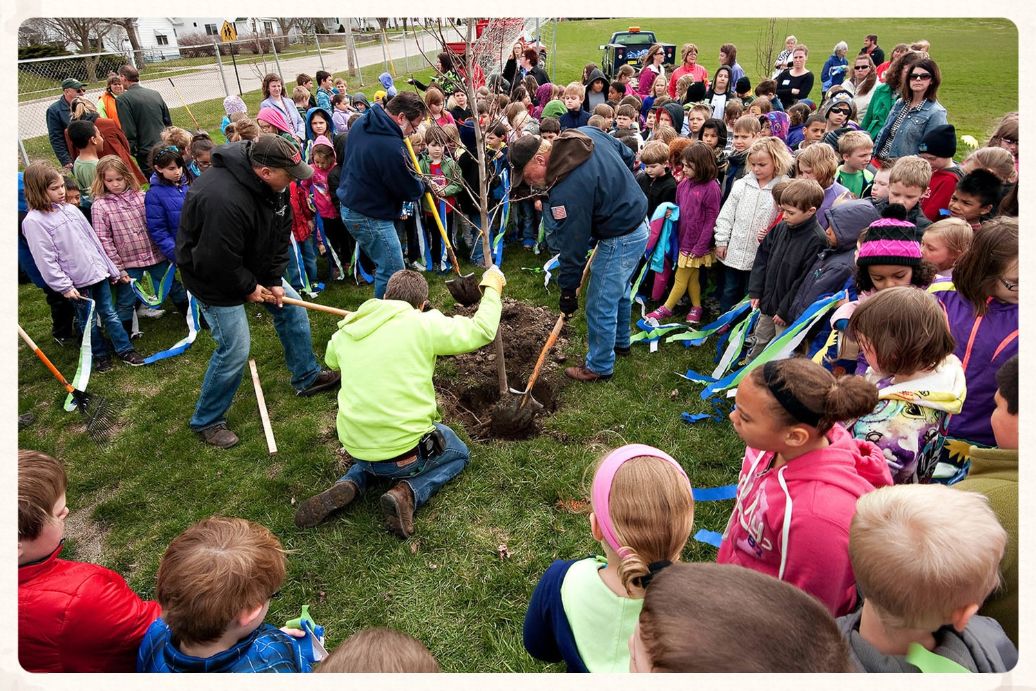 Planting trees with kids for Arbor day at Washington Elementary School.