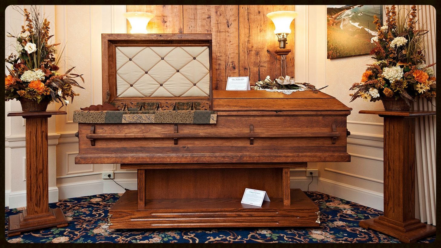 Our Naturalist pine casket withDeep Forest interior displayed on our chapel furniture.