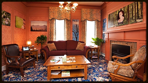 The Aldo Leopold Family Lounge is a safe, quiet, place to relax. Guests can read by the fireplace or visit over a complementary cup of coffee. There is a toy box in the corner for children to entertain themselves.