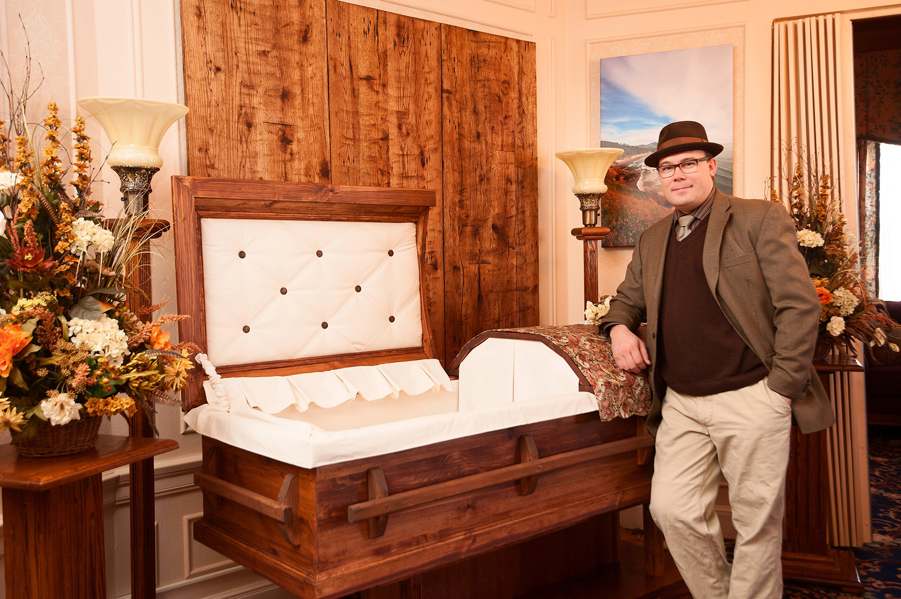 Jonas Zahn pictured with a 100% metal free pine casket--one of more than 75 different styles the company crafts here in Wisconsin.