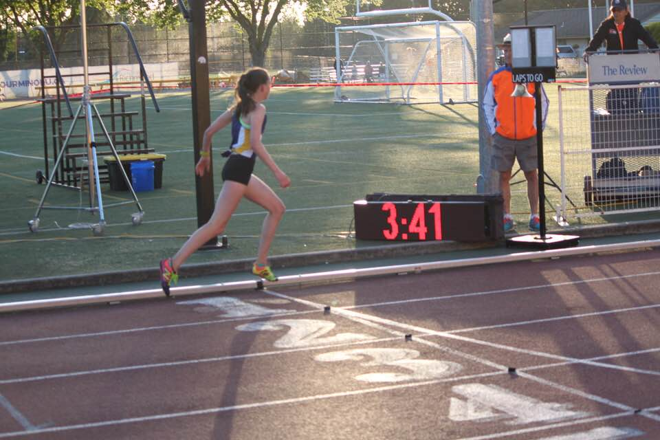 Maya Baechler crossing the finish line in the 13 year old girl's 1200m in new Provincial Record!