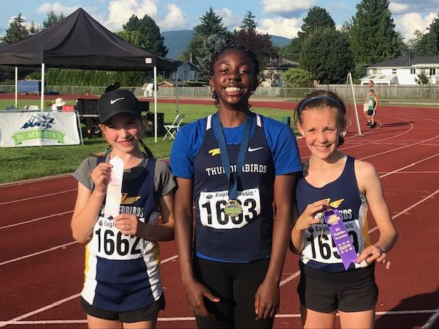 Thunderbird athletes Chloe Symon, Mbunya Tateh, and Kate Logan celebrate their top 8 finishes at BC Athletics JD Pentathlon.