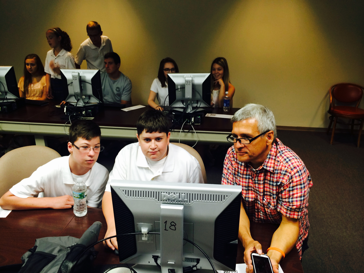 Students working with Carl Wilkens in a diversity-driven avatar project,