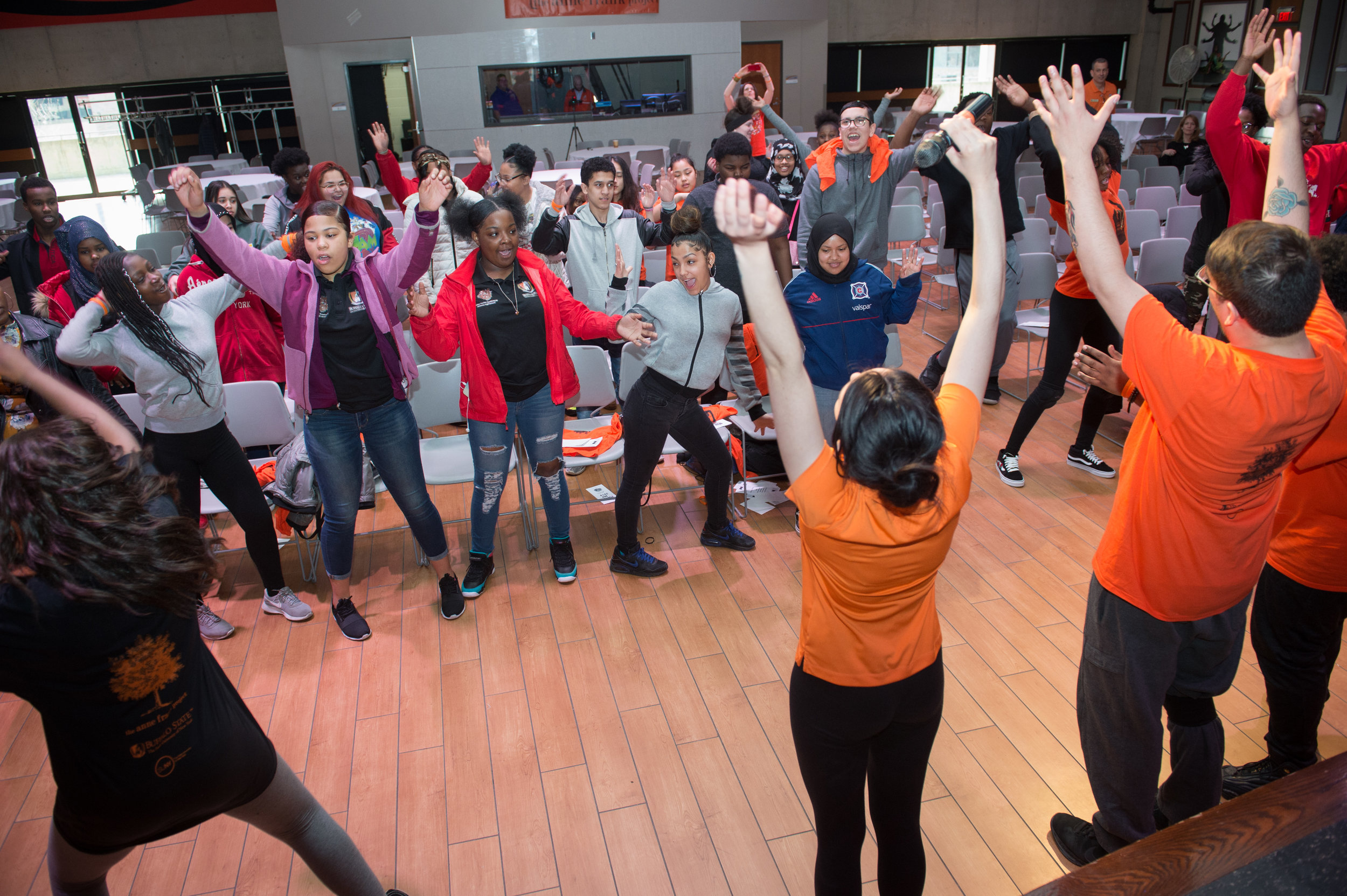 Buffalo State college students lead high schoolers through a kinesthetic post-performance workshop to process the theme of the play.