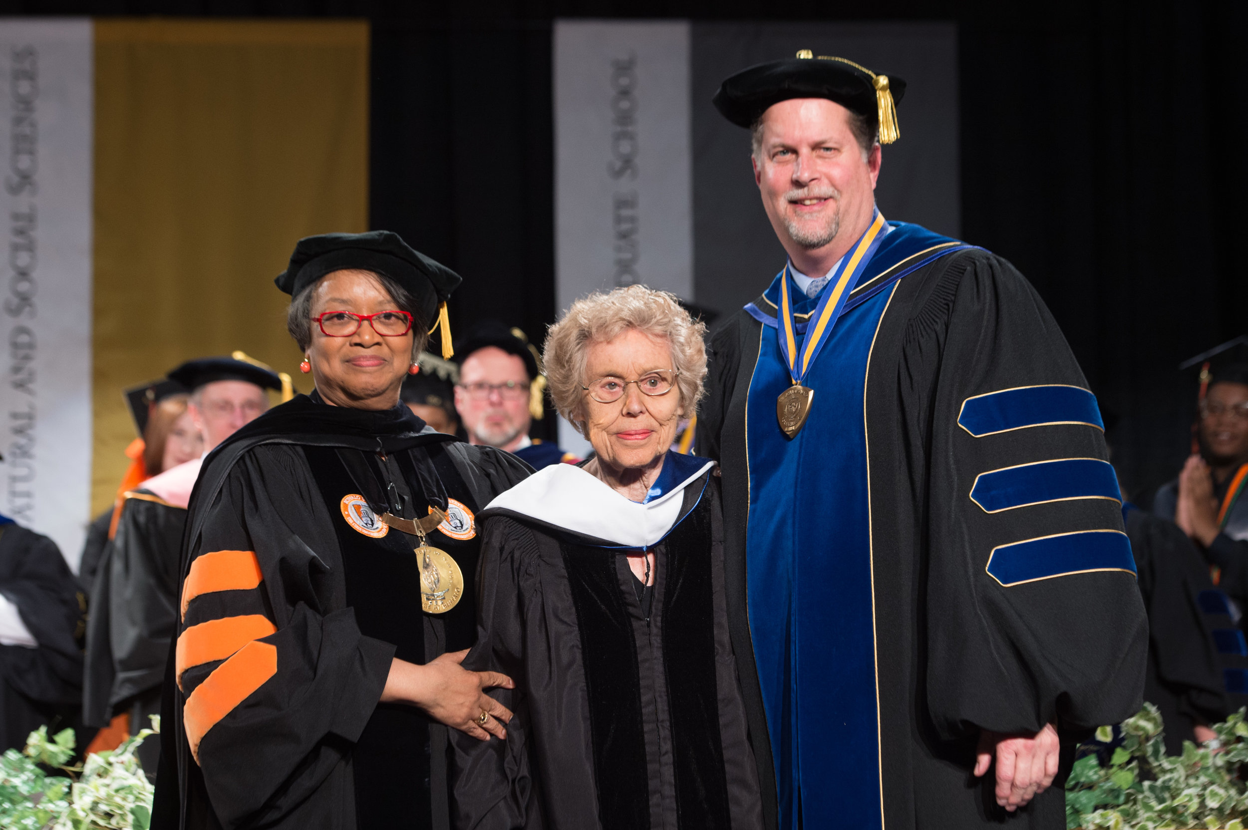 Sophia receiving a SUNY Honorary Doctorate at Buffalo State's May 2019 Commencement ceremony.  Pictured left to right: President Conway-Turner, Sophia Veffer, and Interim Provost Mayrose.