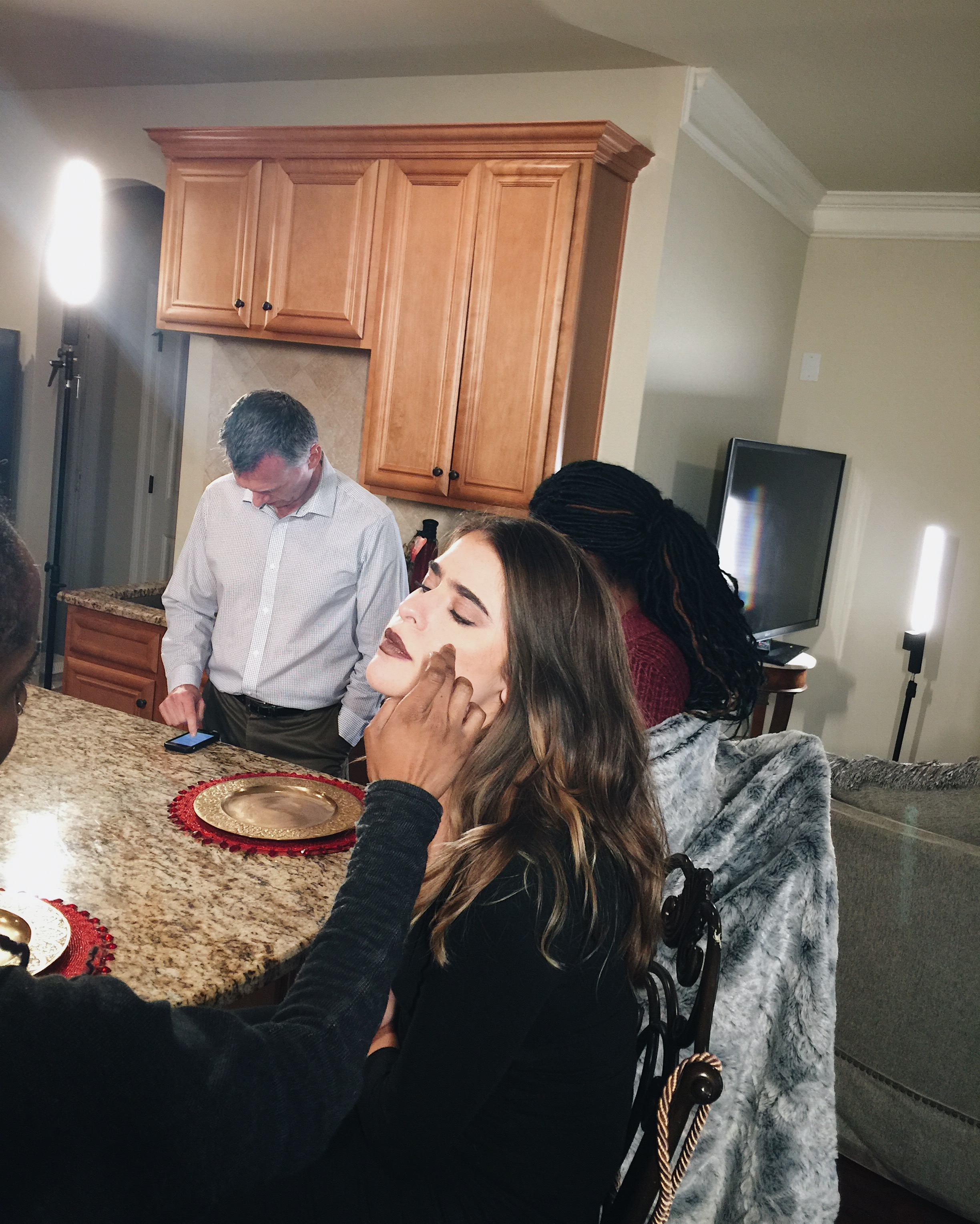 Getting touched up for the commercial I was filming this week
