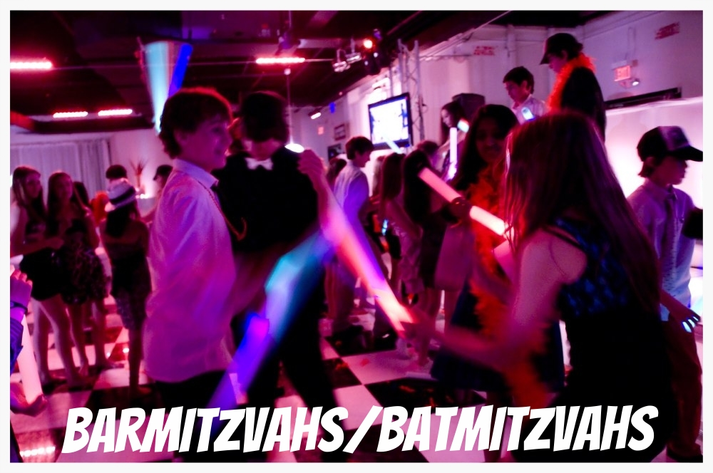 Kids dancing to djs in Toronto at a Mitzvah.