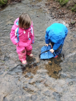 In the stream collecting water. Wellies and waterproofs a good idea!