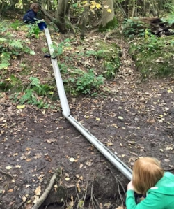 The stream provides water for play and gutter chutes.