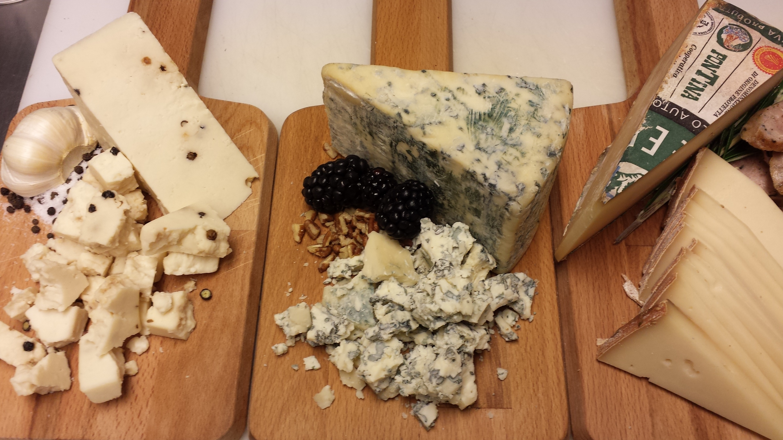 Imported pecorino pepato, gorgonzola dolce, and fontina val d'aosta ready to go for happy hour.