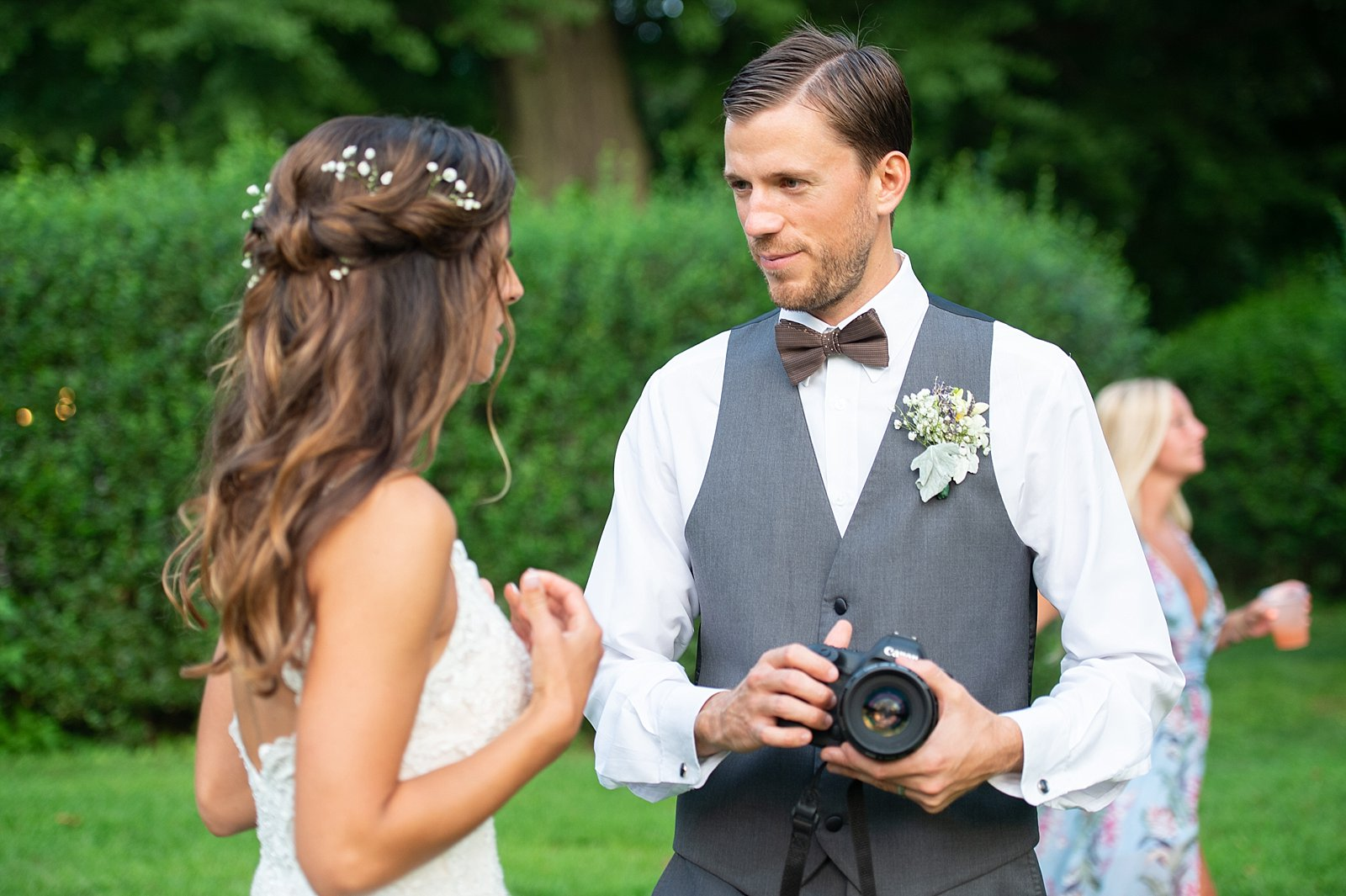 I don't trust just anyone to hold my camera, but I guess it's okay when the groom is a photographer too!