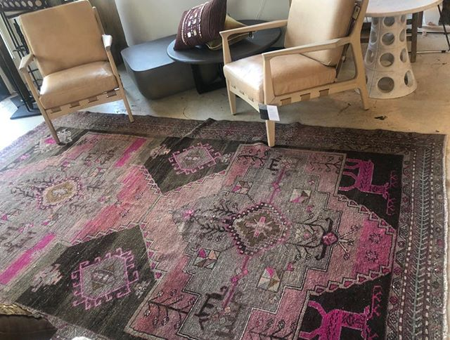 Love the fuchsia deer on this rug!