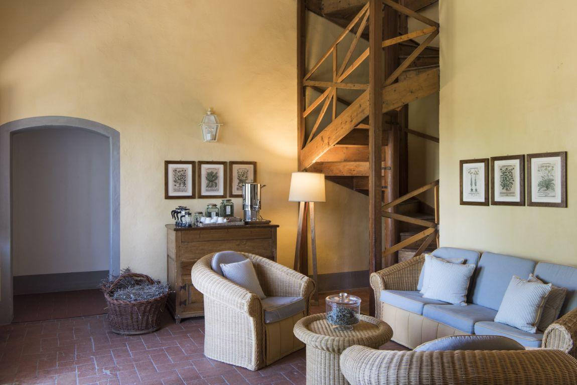 apt_livingroom_spiralstairs.jpg