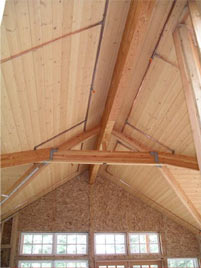 The house features vaulted ceiliings above the upper story. The beams are laminated Douglas Fir. This photo was taken facing east.