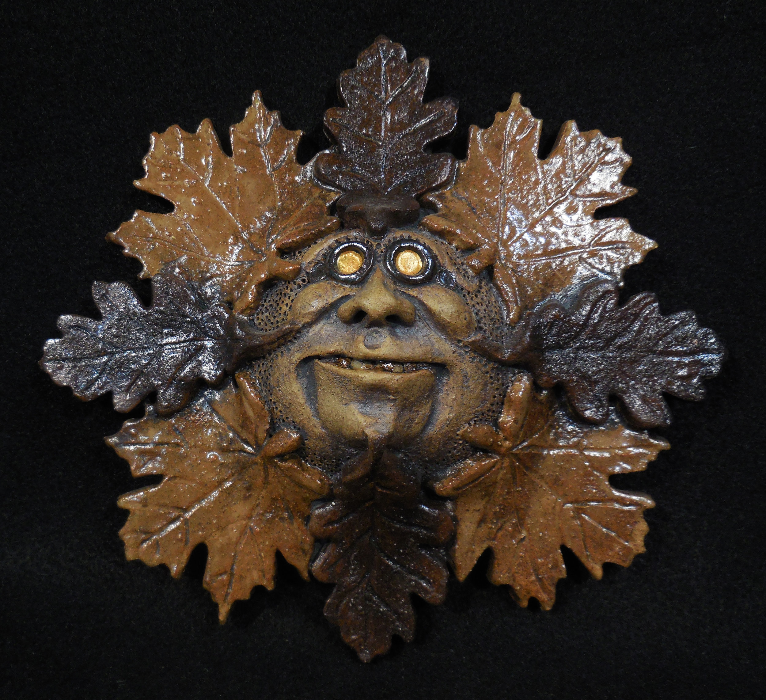 GREEN MAN OAK LEAF ROUND.jpg