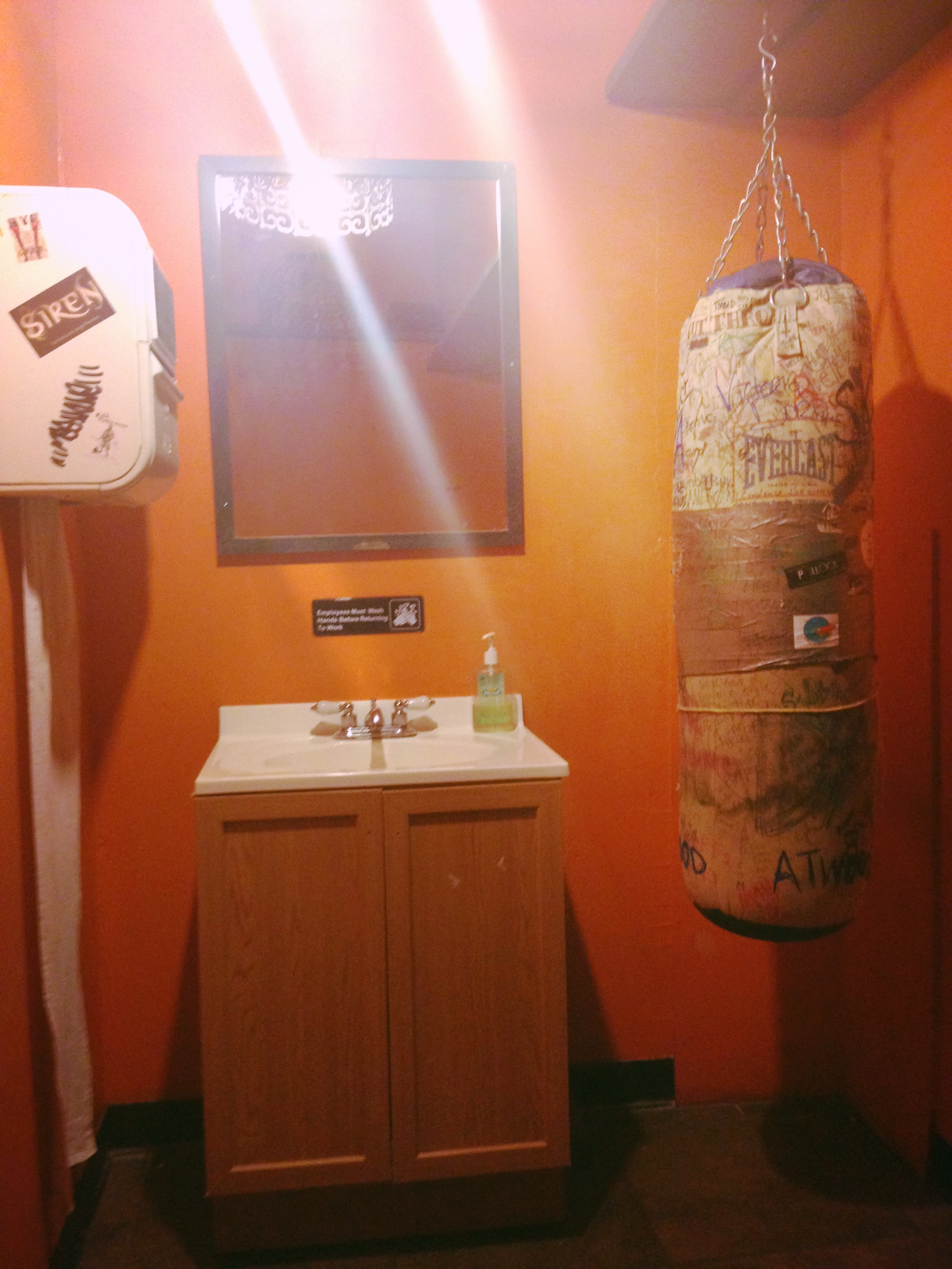 because all women's restrooms should have punching bags...
