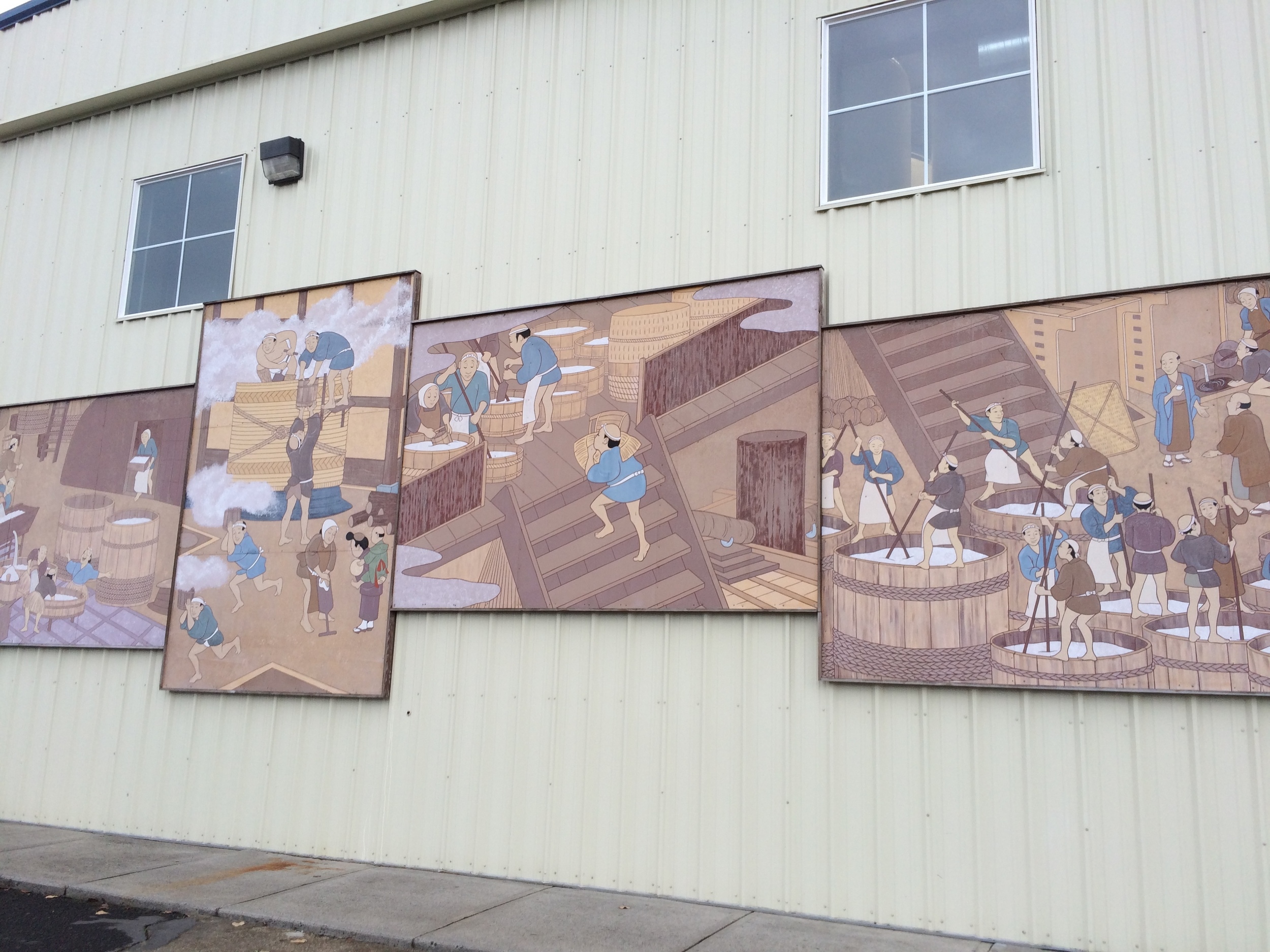 pictures of sake making on the outside wall of sake one