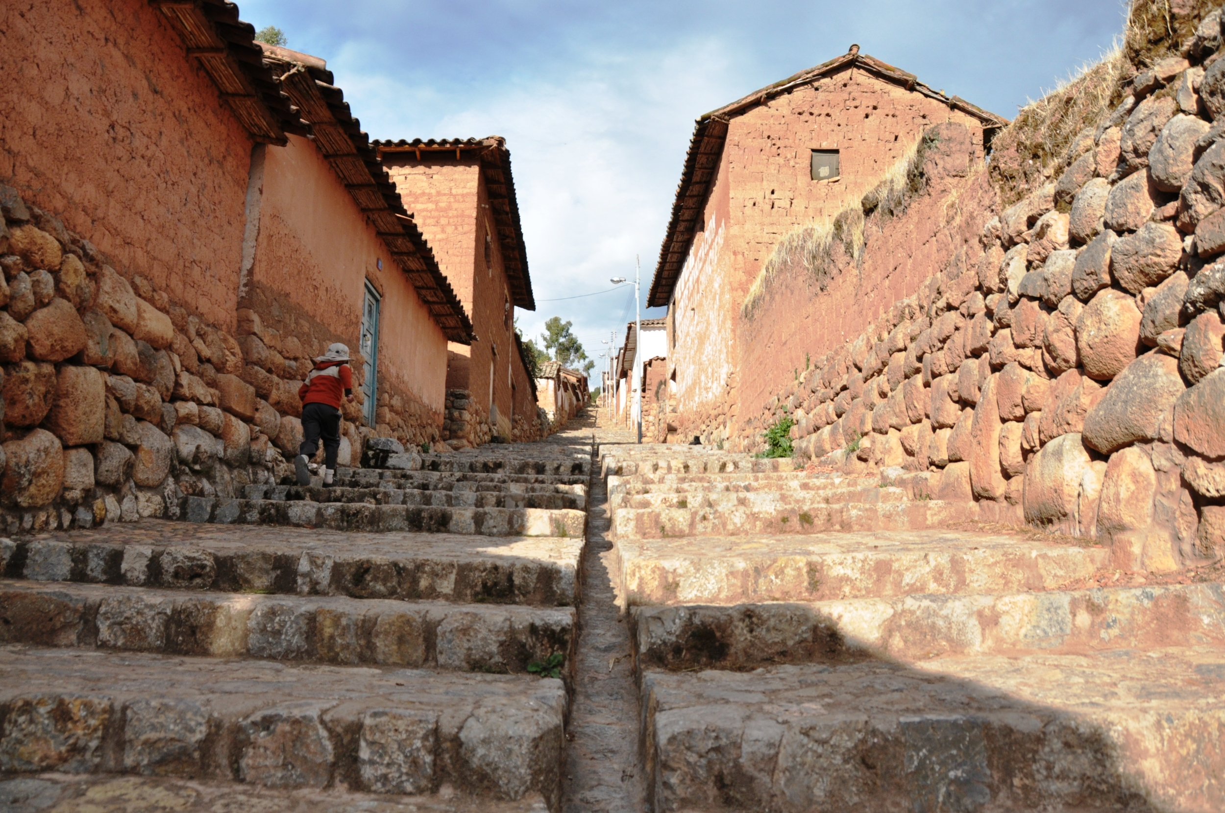 walking up to chinchero - steeper and harder than it looks, but the kid ran up!