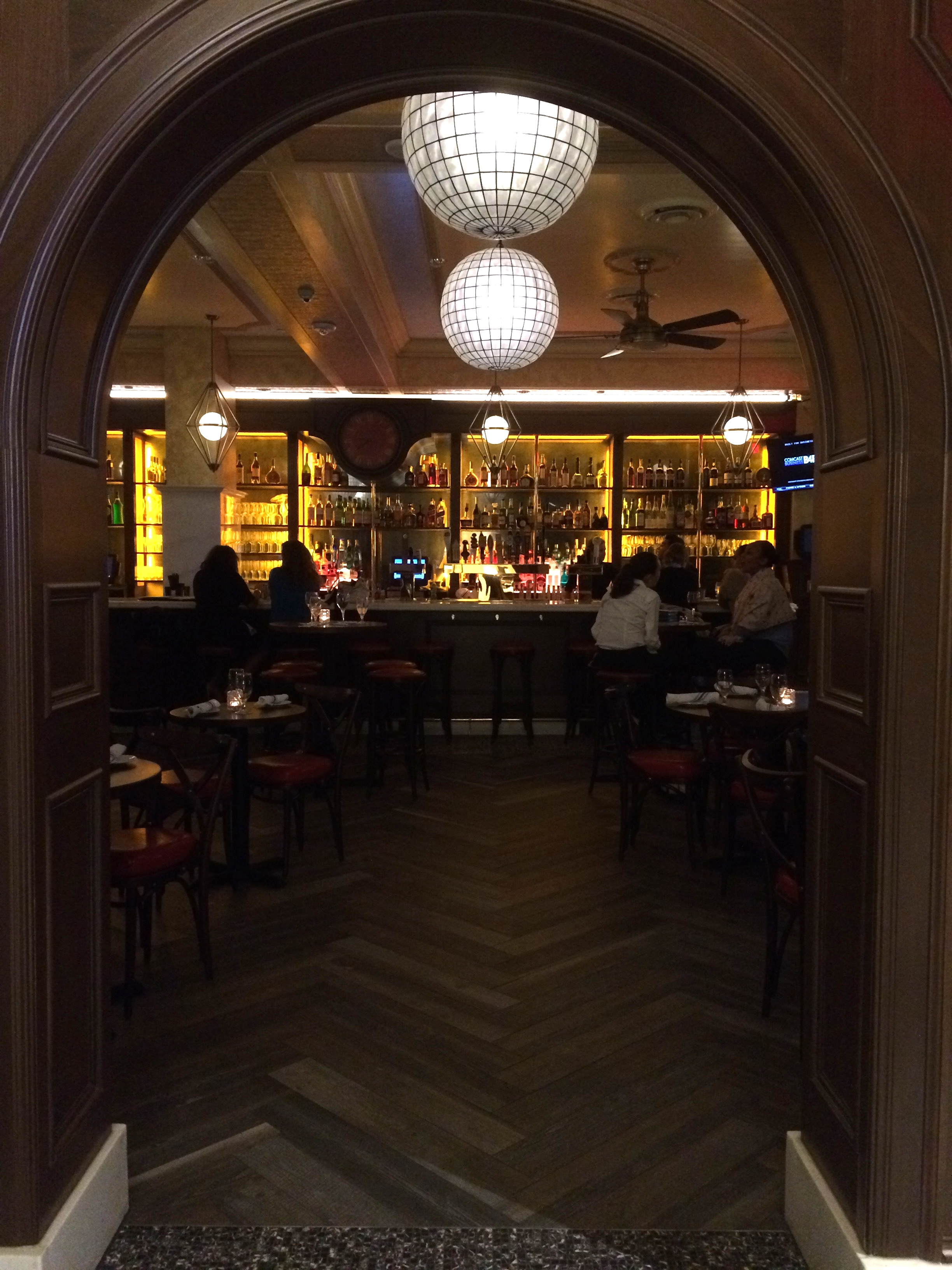 Looking into the bar as you walk in - love the floors!