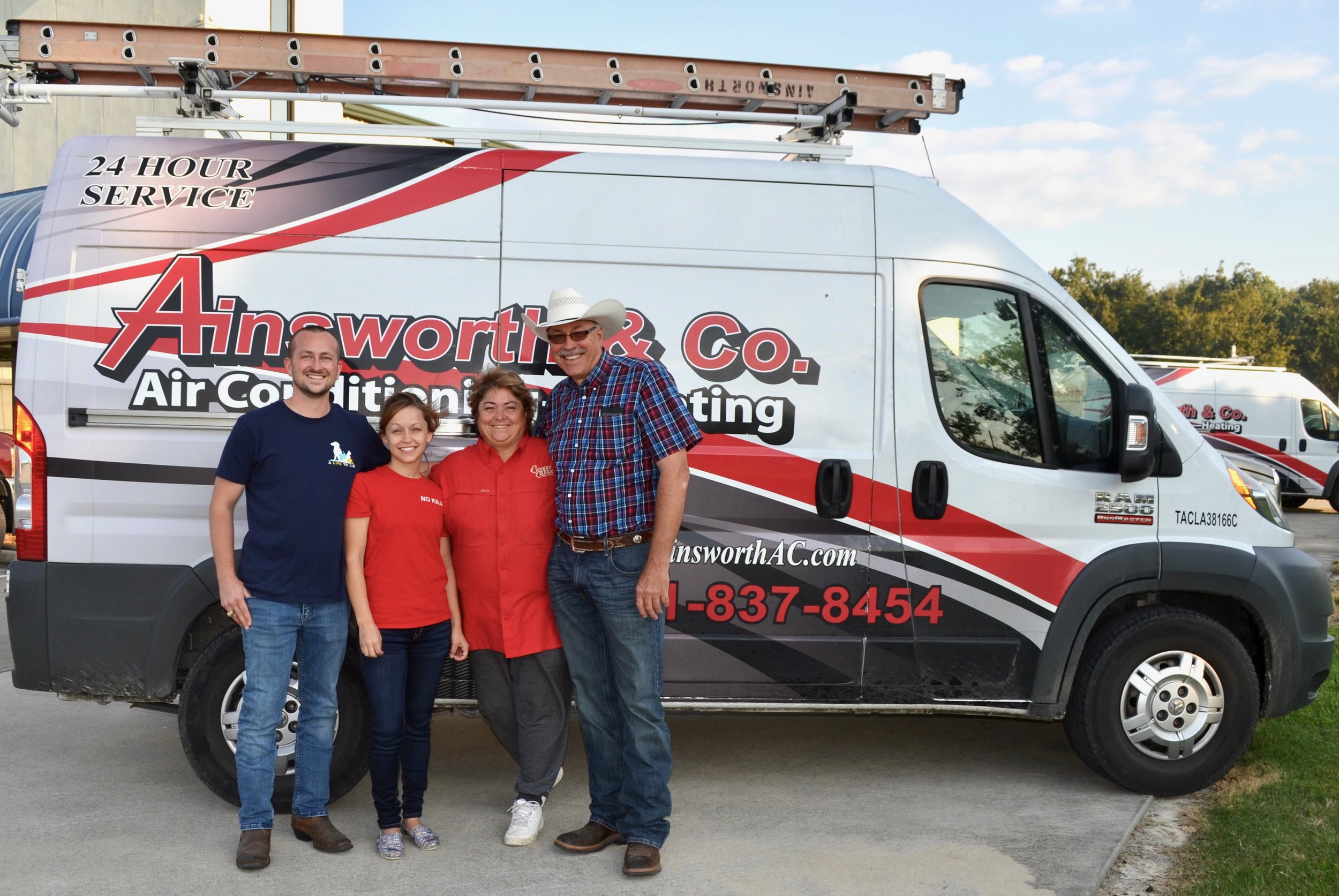 Robin and Junior Forrest (right), owners of Ainsworth and Company Air Conditioning and Heating, recently donated a refrigerator to A Life to Live for storing important supplies. Joining the Forrests are Jay Garrett, founder and executive director, and Magan Gonzales, co-founder and program director, of A Life to Live. Learn more about the organization at www.adopttosave.org.