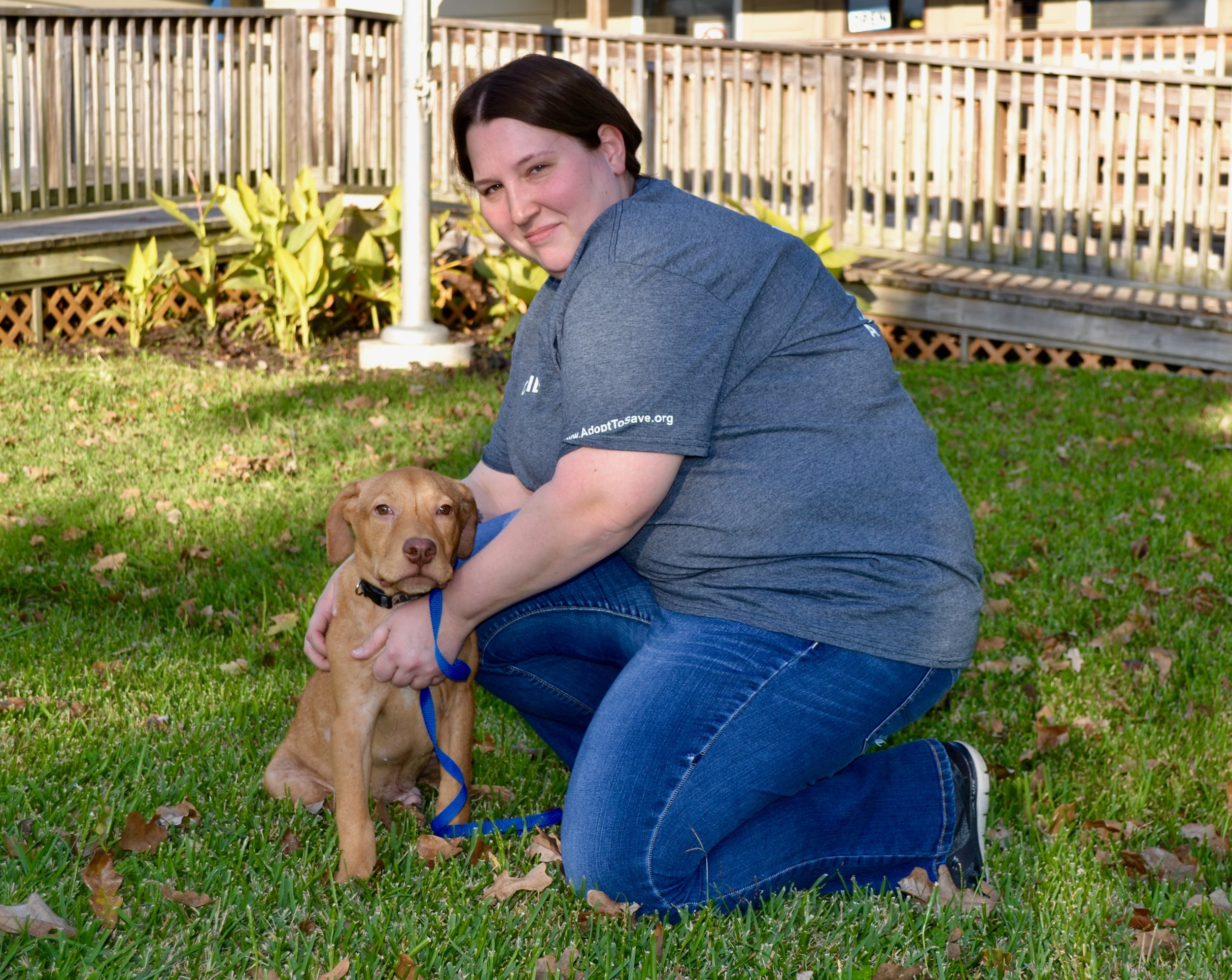 Anna with newly enrolled foster dog, Cowboy.