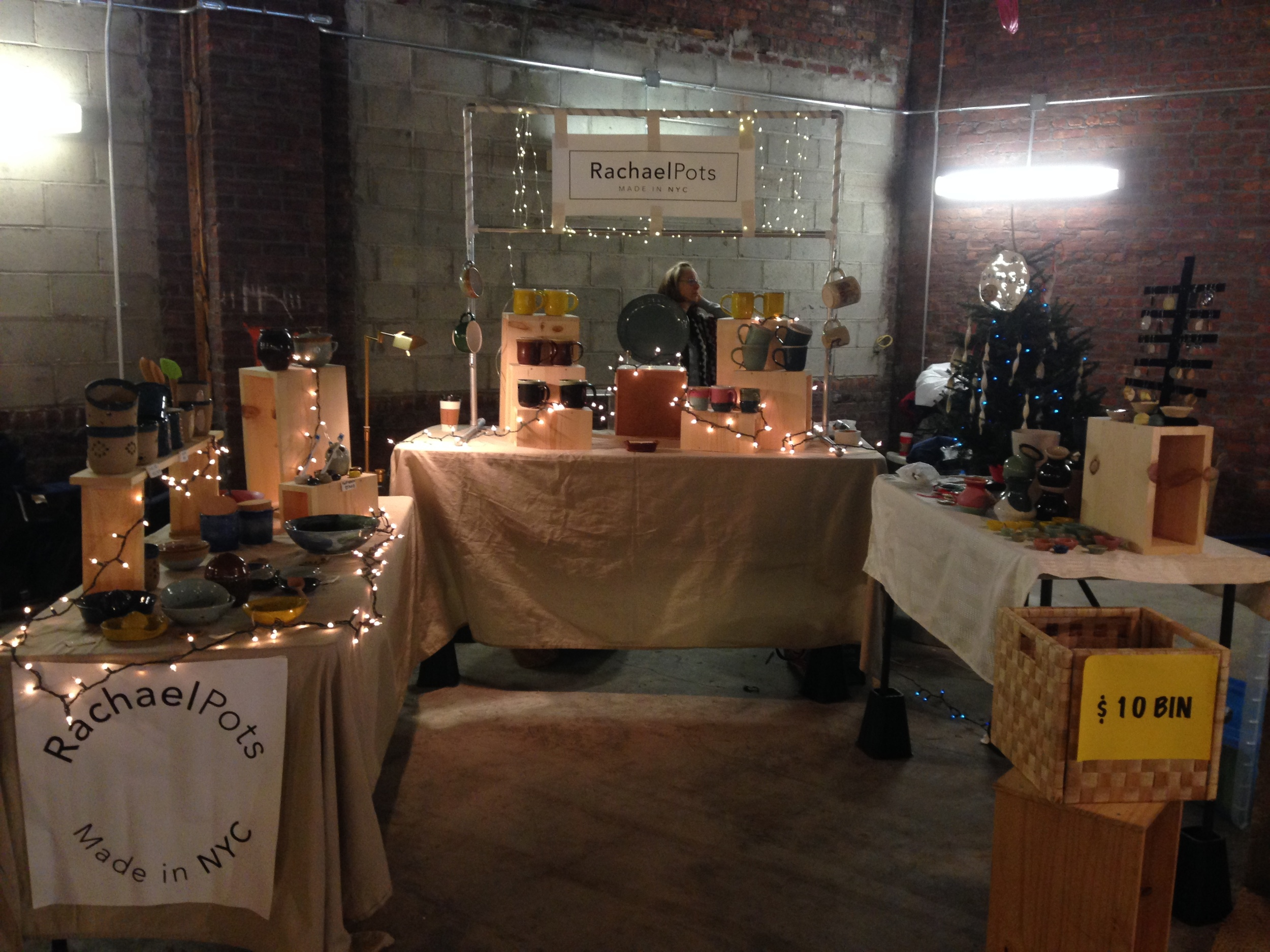 Here is a shot from our set up at the Shops at Atlas Park in Queens this year! A bit of a dark space, we made the best of it with twinkling lights!
