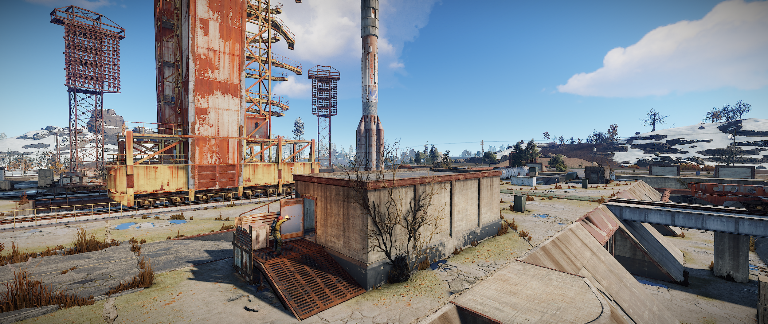 Head past the rocket to the stone building with metal ramp