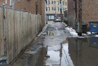 Laneway with impermeable pavement.