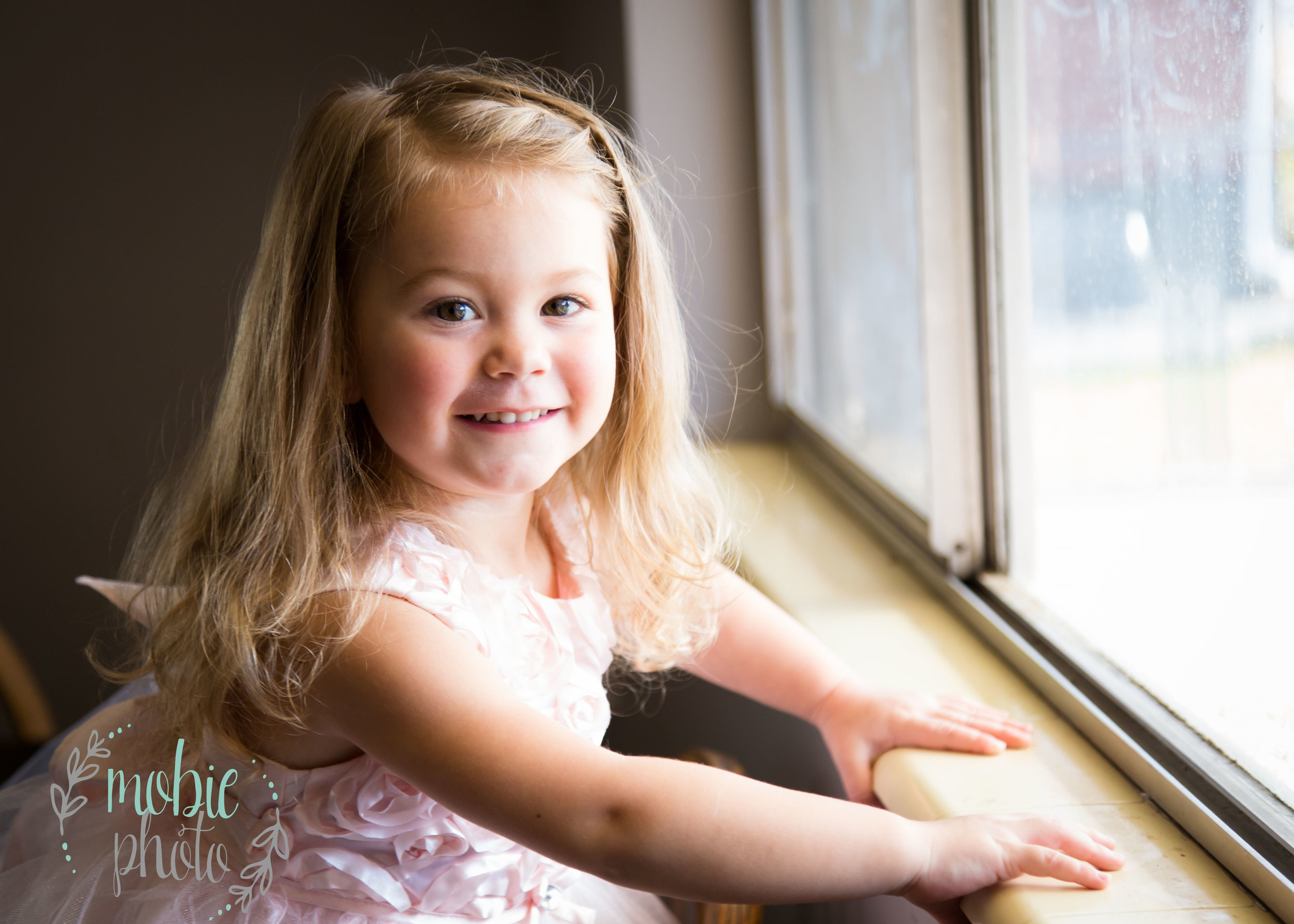 Two year old at her kitchen window