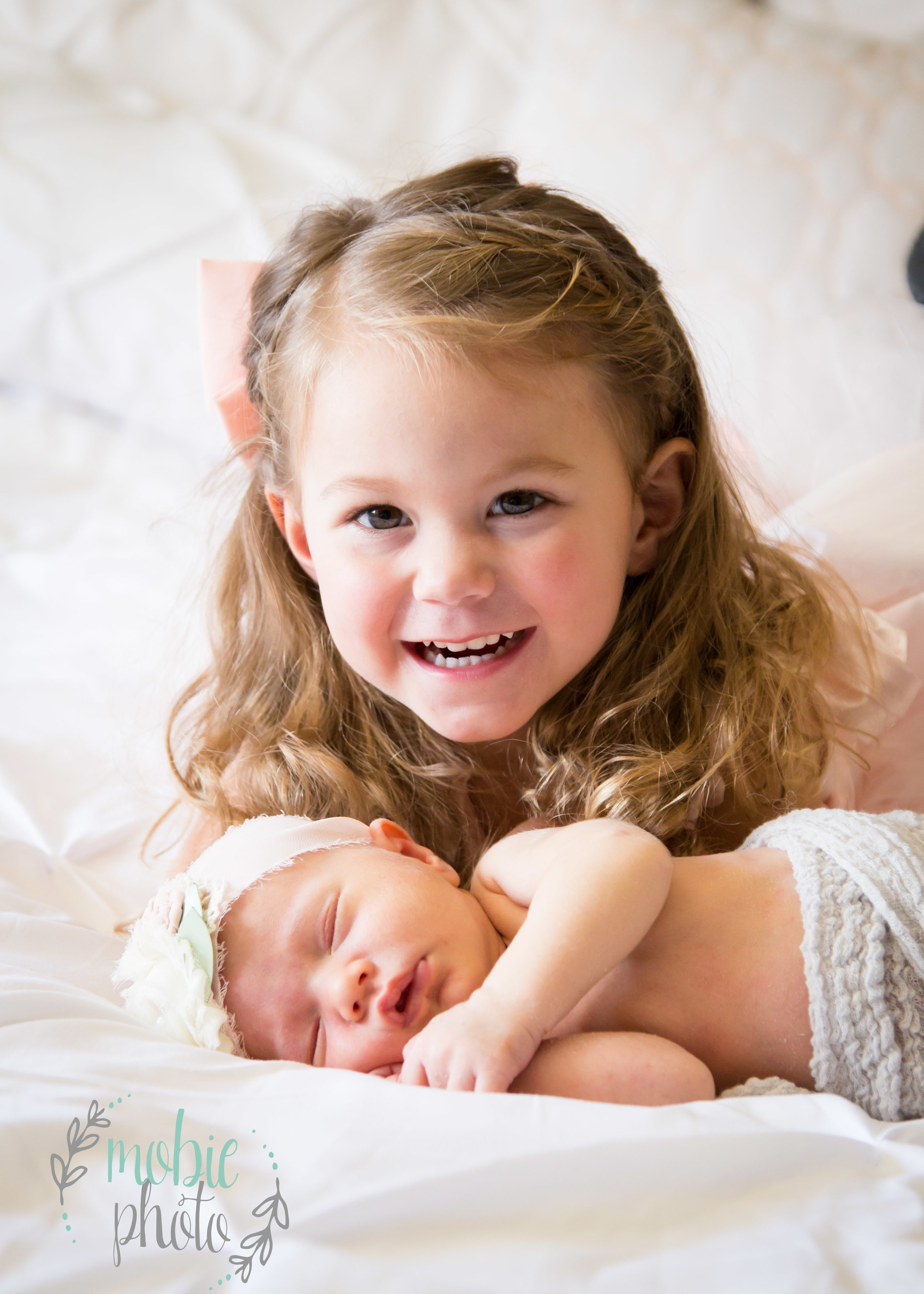 Two year old with her newborn sister