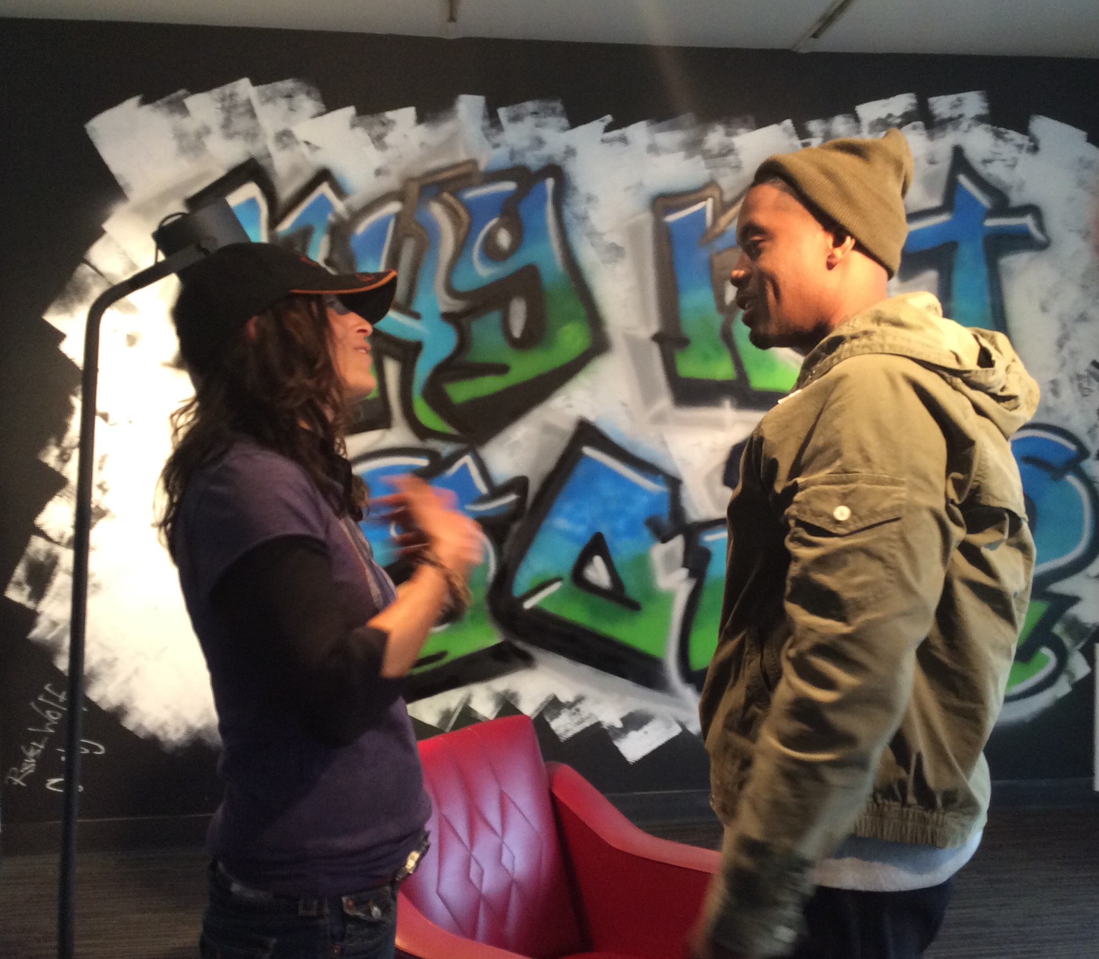 """October 15 2014,Nas and The Wolf in front of the """"Why Not You?"""" wall."""