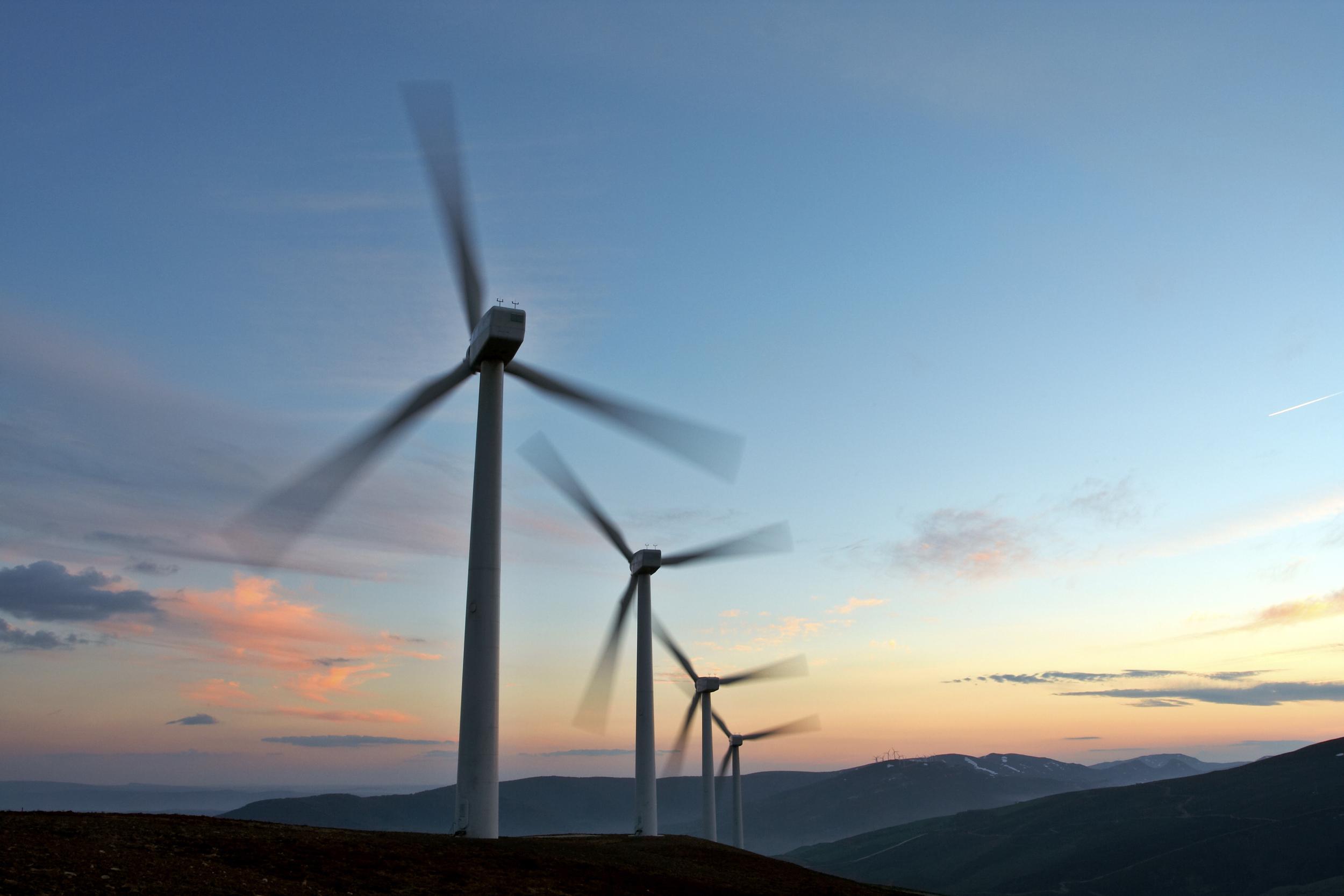bigstock-Wind-Turbine-Farm-Turning-mov-517106.jpg